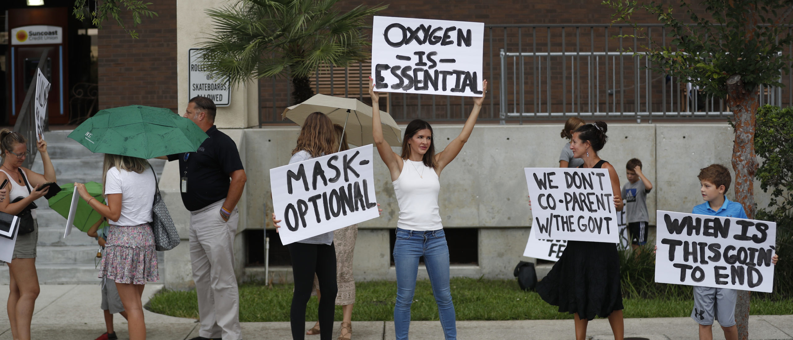 Families protest any potential mask mandates before the Hillsborough County Schools Board meeting held at the district office on July 27, 2021 in Tampa, Florida. The Centers for Disease Control and Prevention recommended those who are vaccinated should wear masks indoors including students returning to school.