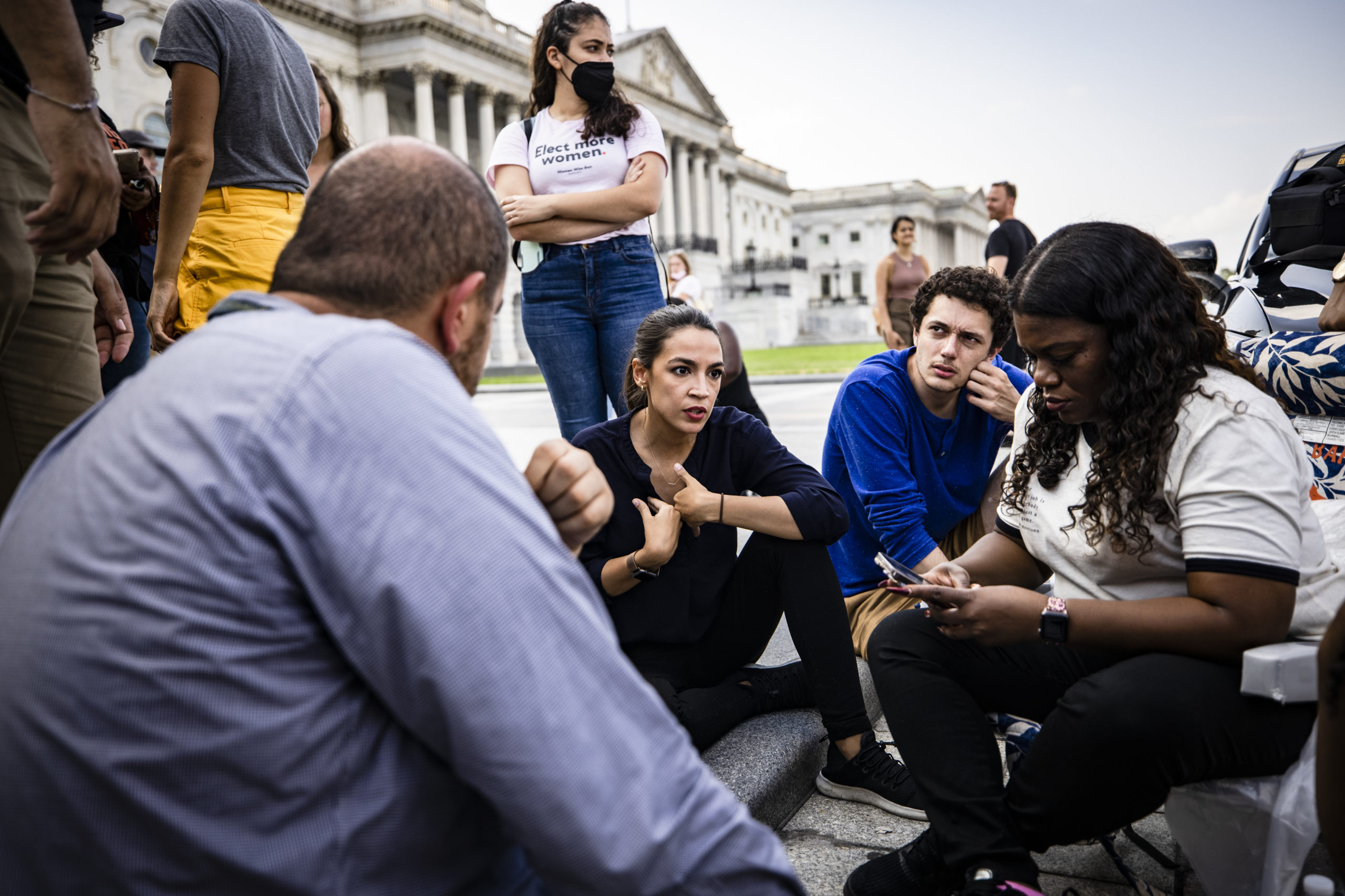 WASHINGTON, DC - AUGUST 01: U.S. Representatives Alexandria Ocasio-Cortez (D-NY) (C) and Cori Bush (D-MO) (R) continue their protest for an extension of the eviction moratorium on the steps to the House of Representatives at the U.S. Capitol Building on August 1, 2021 in Washington, DC. The eviction moratorium, which ended July 31st, helped 2 million people stay in their homes who suffered financial hardships due to the coronavirus (COVID-19) pandemic. Those people are now at risk of losing their homes. (Photo by Samuel Corum/Getty Images)