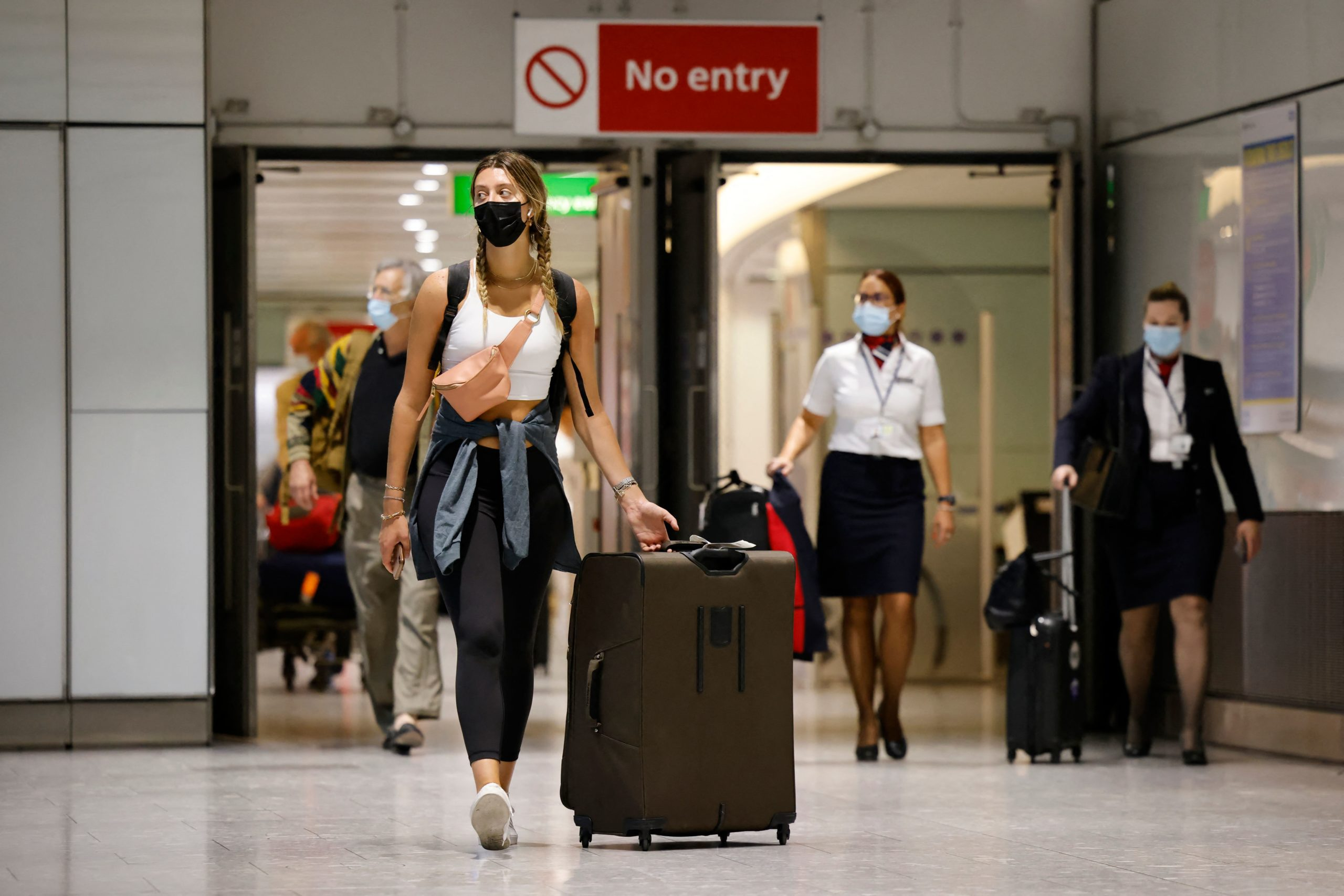 Travellers arrive at Heathrow's Terminal 5 in west London on August 2, 2021 as quarantine restrictions ease. - People fully vaccinated in the United States and European Union, except France will now be allowed to travel to England without having to quarantine on arrival. (Photo by Tolga Akmen / AFP) (Photo by TOLGA AKMEN/AFP via Getty Images)