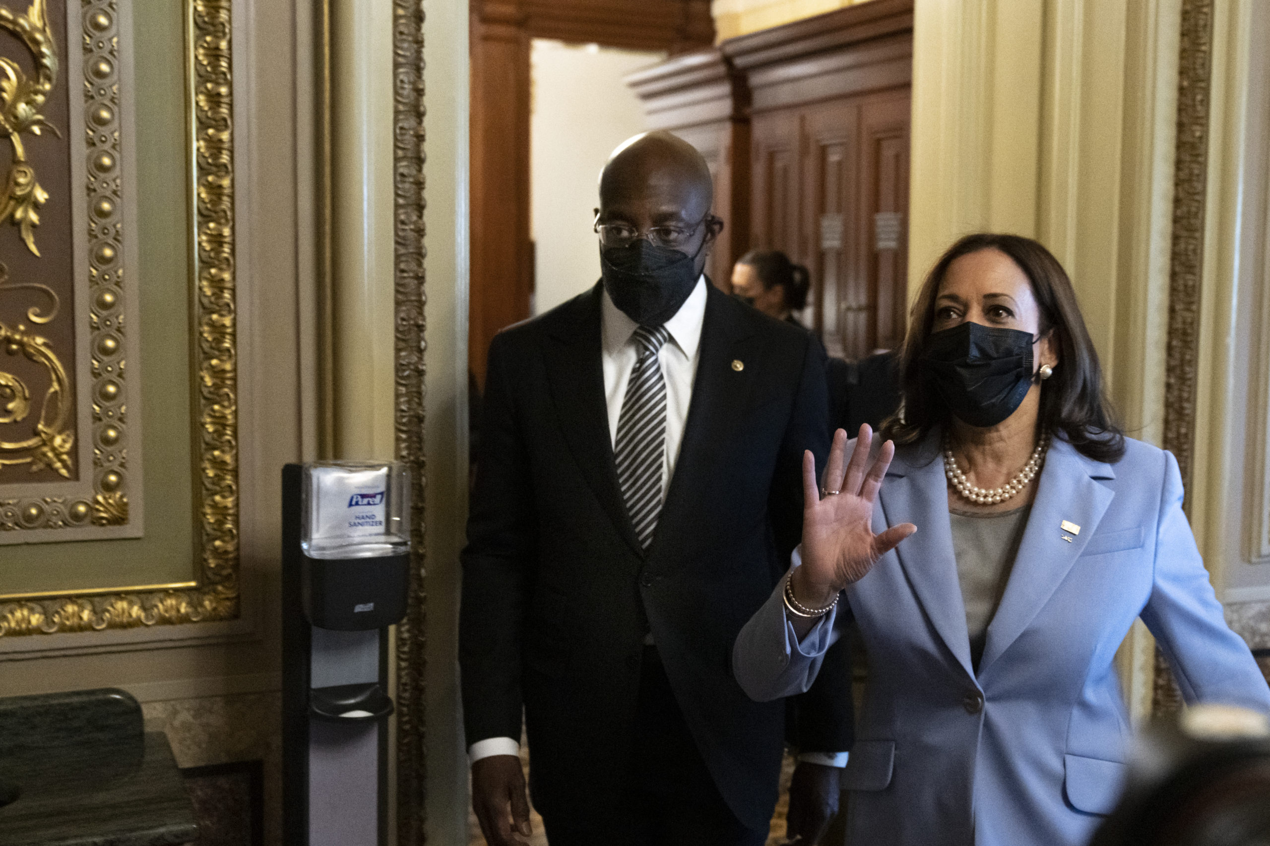 Sen. Raphael Warnock (D-GA) and U.S. Vice President Kamala Harris exit a meeting with family members of former President Lyndon Baines Johnson about voting rights issues at the U.S. Capitol on August 2, 2021 in Washington, DC. The bipartisan group of senators finalized the legislative text of the $1 trillion infrastructure bill over the weekend and will now move on to the amendments process this week. The legislation will fund projects for improvements to roads, bridges, dams, climate resiliency and broadband internet. (Photo by Drew Angerer/Getty Images)