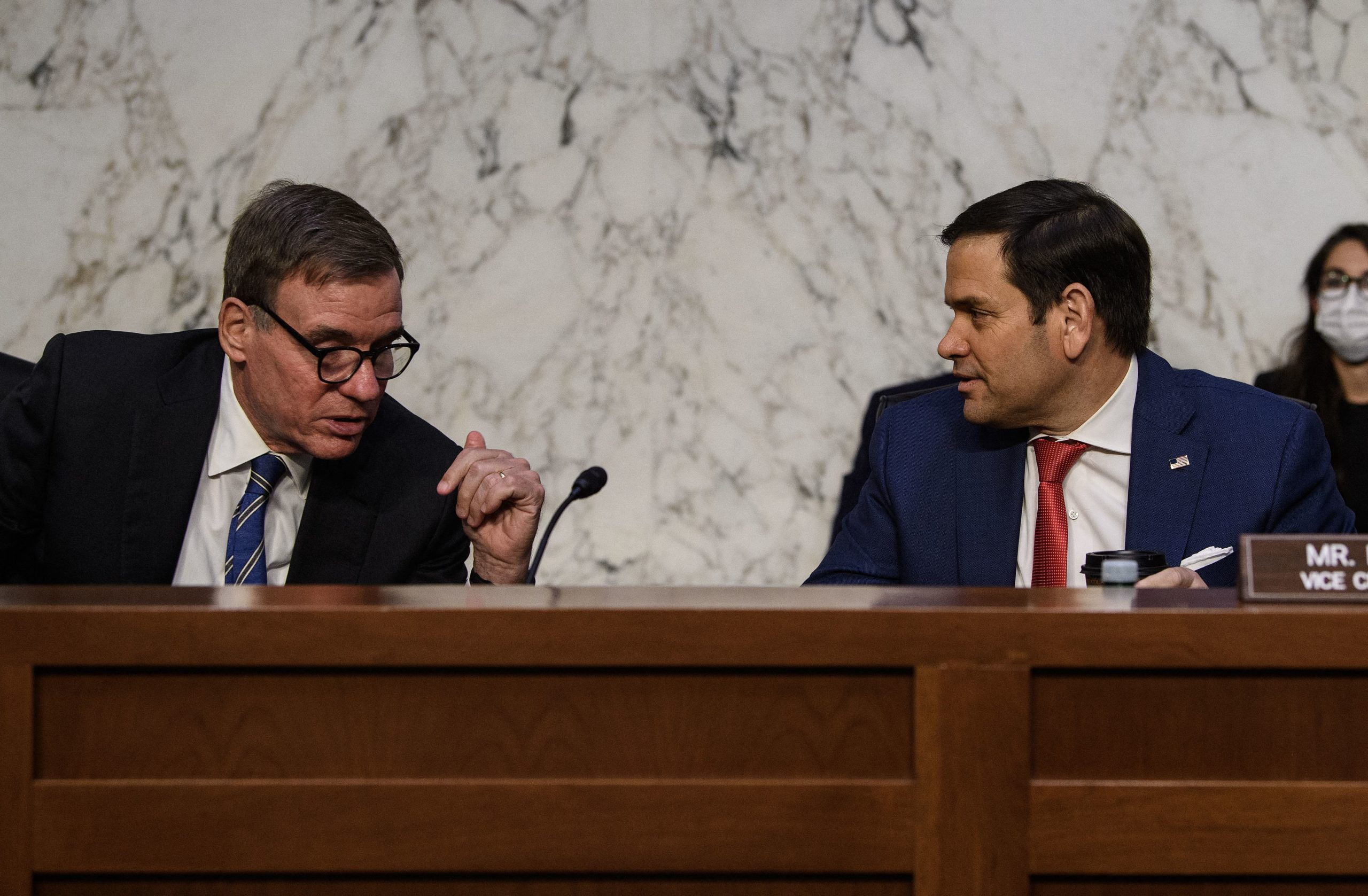 US Democratric Senator from Virginia Mark Warner (L) speaks with Republican Senator Marco Rubio before a hearing of the Senate Intelligence Select Committee on the threats to national security from China on Capitol Hill in Washington, DC, on August 4, 2021. (Photo by Nicholas Kamm / AFP) (Photo by NICHOLAS KAMM/AFP via Getty Images)