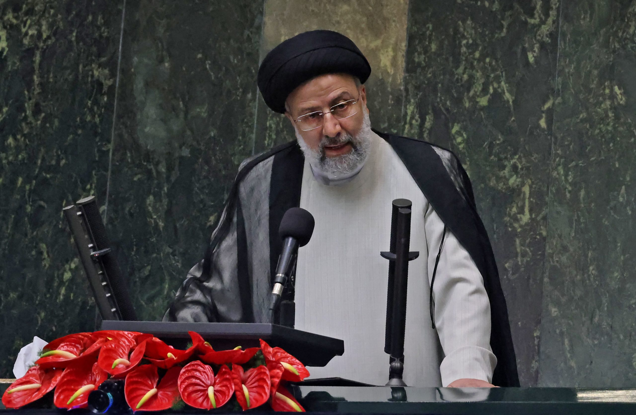 Iranian President Ebrahim Raisi addresses his nation's parliament on Aug. 5. (Atta Kenare/AFP via Getty Images)