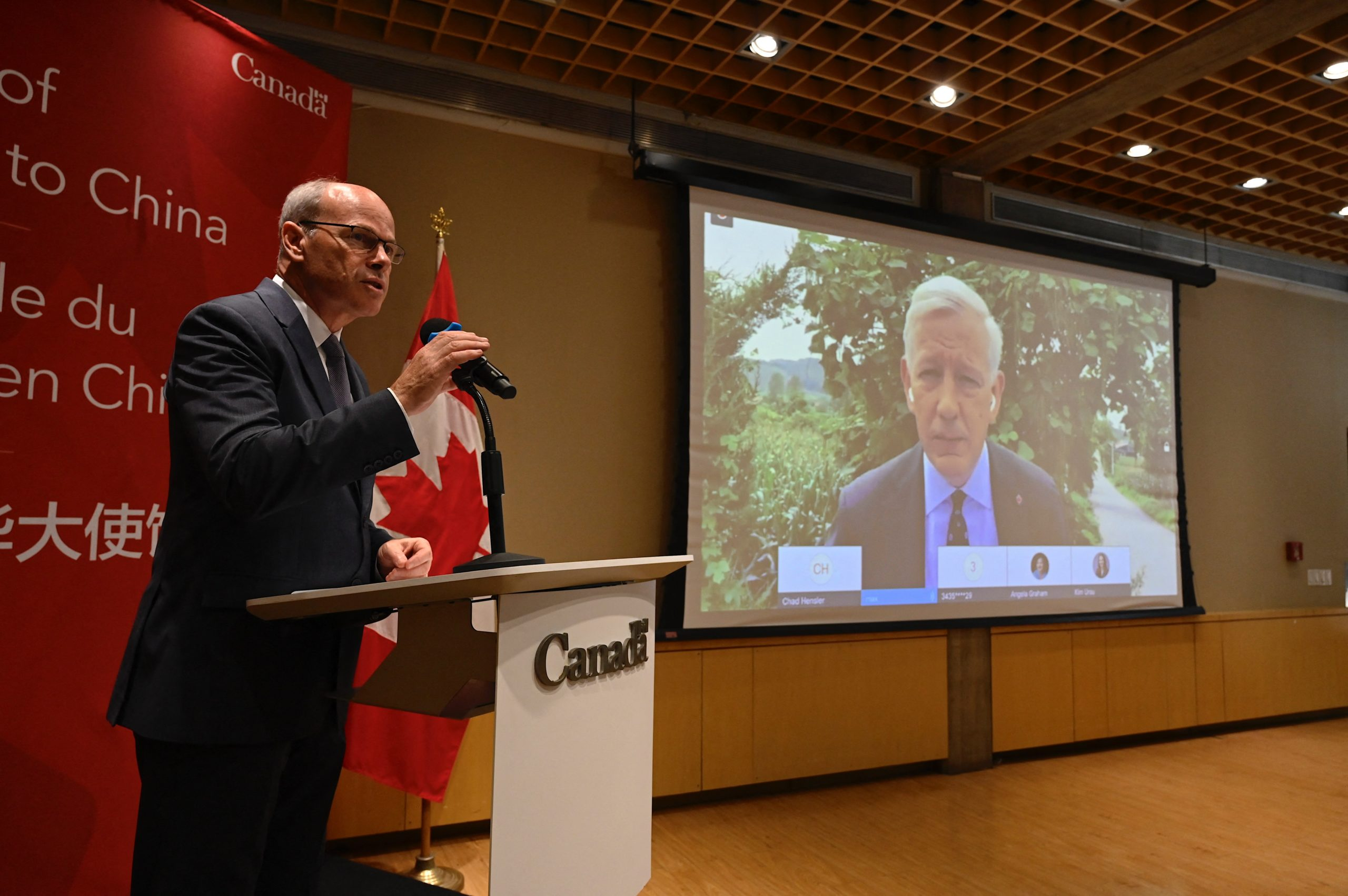 A screen shows Canadian Ambassador Dominic Barton delivering a statement from Dandong via video link at the Canadian embassy in Beijing on August 11, 2021 as Canadian businessman Michael Spavor was sentenced to 11 years after finding him guilty of spying. (Photo by JADE GAO / AFP) (Photo by JADE GAO/AFP via Getty Images)