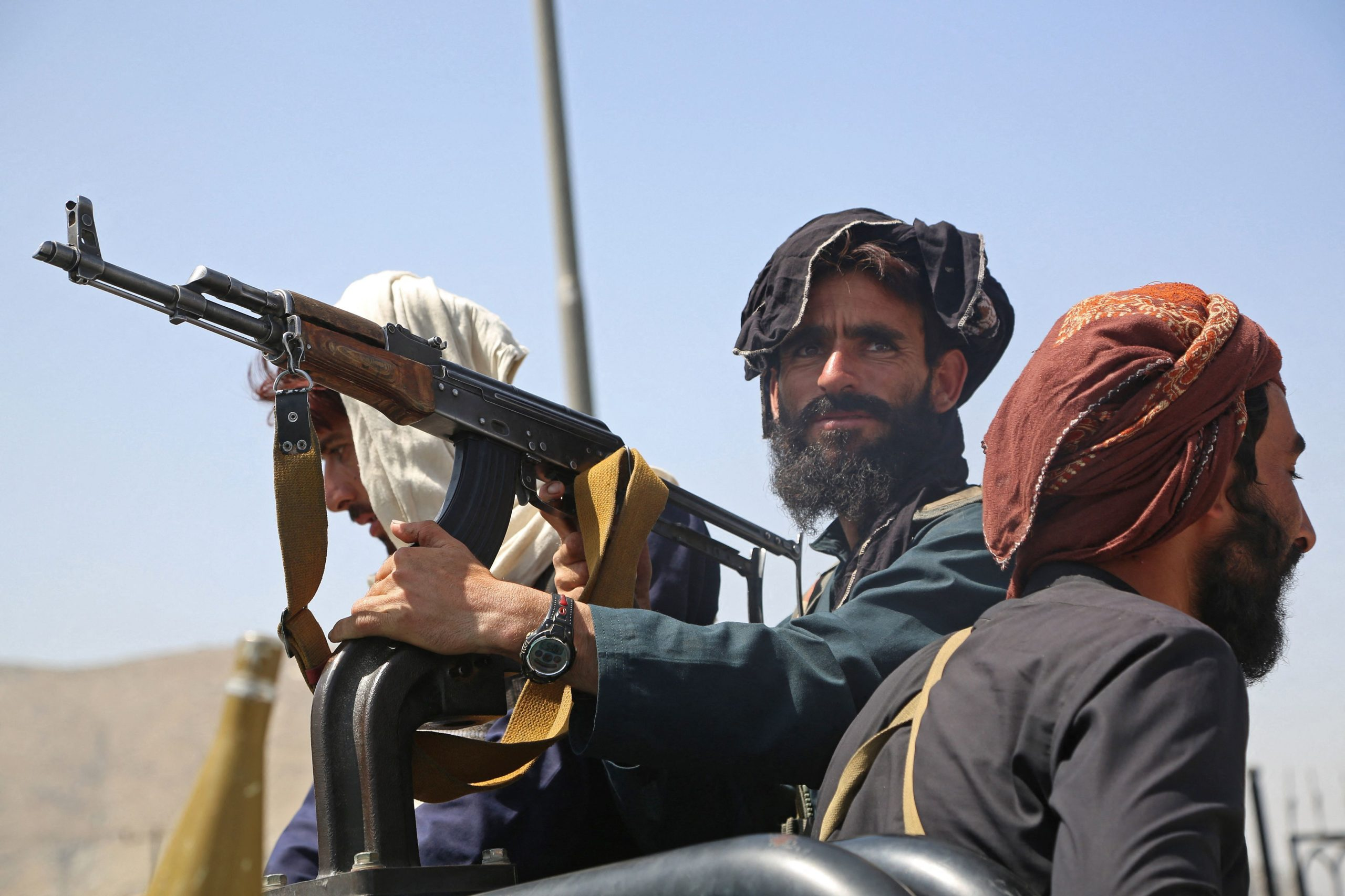 TOPSHOT - Taliban fighters stand guard in a vehicle along the roadside in Kabul on August 16, 2021, after a stunningly swift end to Afghanistan's 20-year war, as thousands of people mobbed the city's airport trying to flee the group's feared hardline brand of Islamist rule. (Photo by - / AFP) / The erroneous mention[s] appearing in the metadata of this photo by Zakeria HASHIMI has been modified in AFP systems in the following manner: [-] instead of [Zakeria Hashimi]. Please immediately remove the erroneous mention[s] from all your online services and delete it (them) from your servers. If you have been authorized by AFP to distribute it (them) to third parties, please ensure that the same actions are carried out by them. Failure to promptly comply with these instructions will entail liability on your part for any continued or post notification usage. Therefore we thank you very much for all your attention and prompt action. We are sorry for the inconvenience this notification may cause and remain at your disposal for any further information you may require. (Photo by -/AFP via Getty Images)