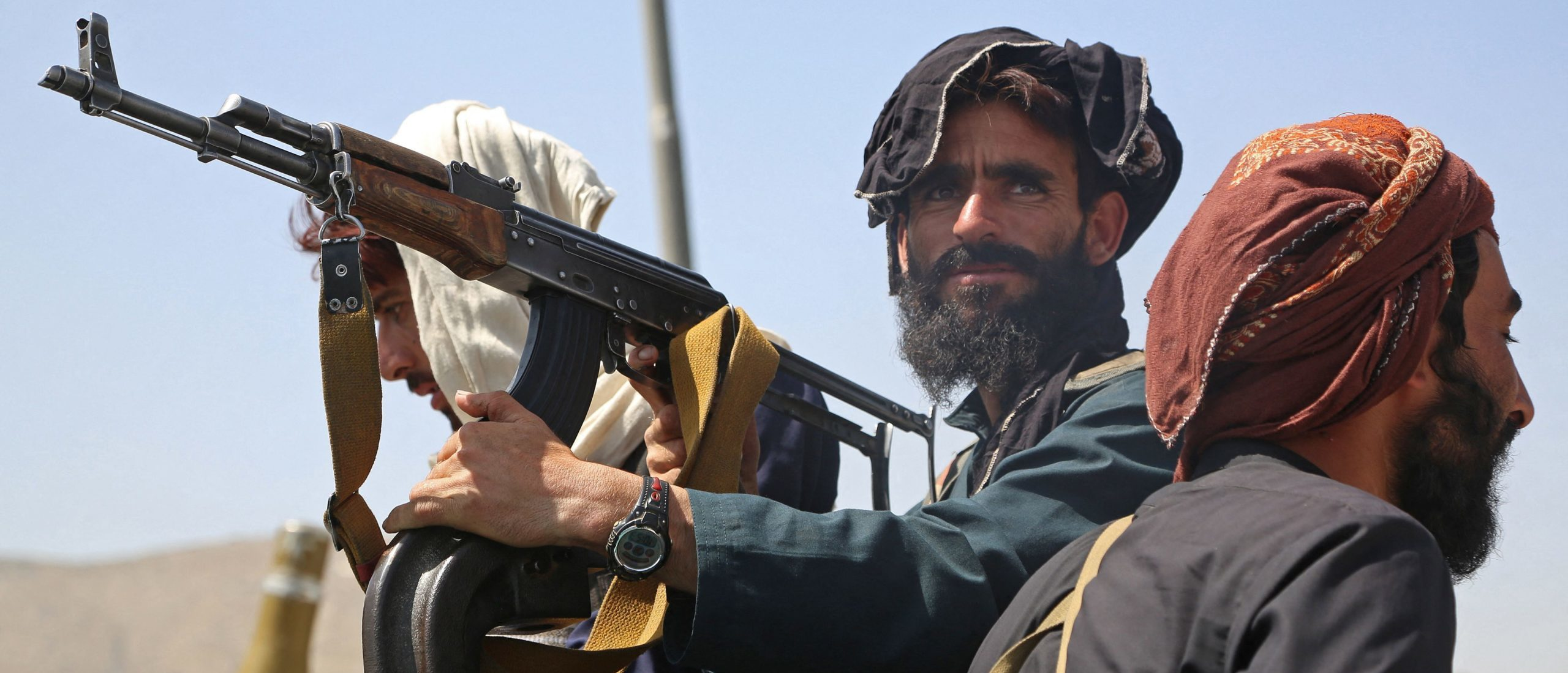 Taliban fighters stand guard in a vehicle along the roadside in Kabul on Monday. (AFP via Getty Images)