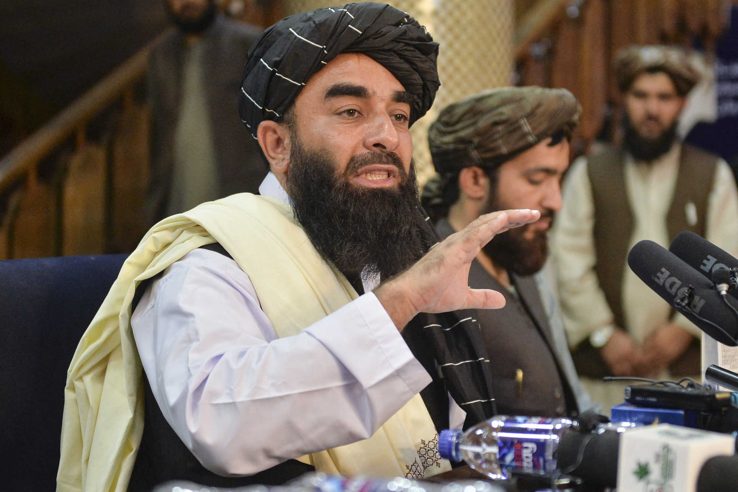 Taliban spokesman Zabihullah Mujahid speaks during a press conference in Kabul, Afghanistan on Tuesday. (Hoshang Hashimi/AFP via Getty Images)