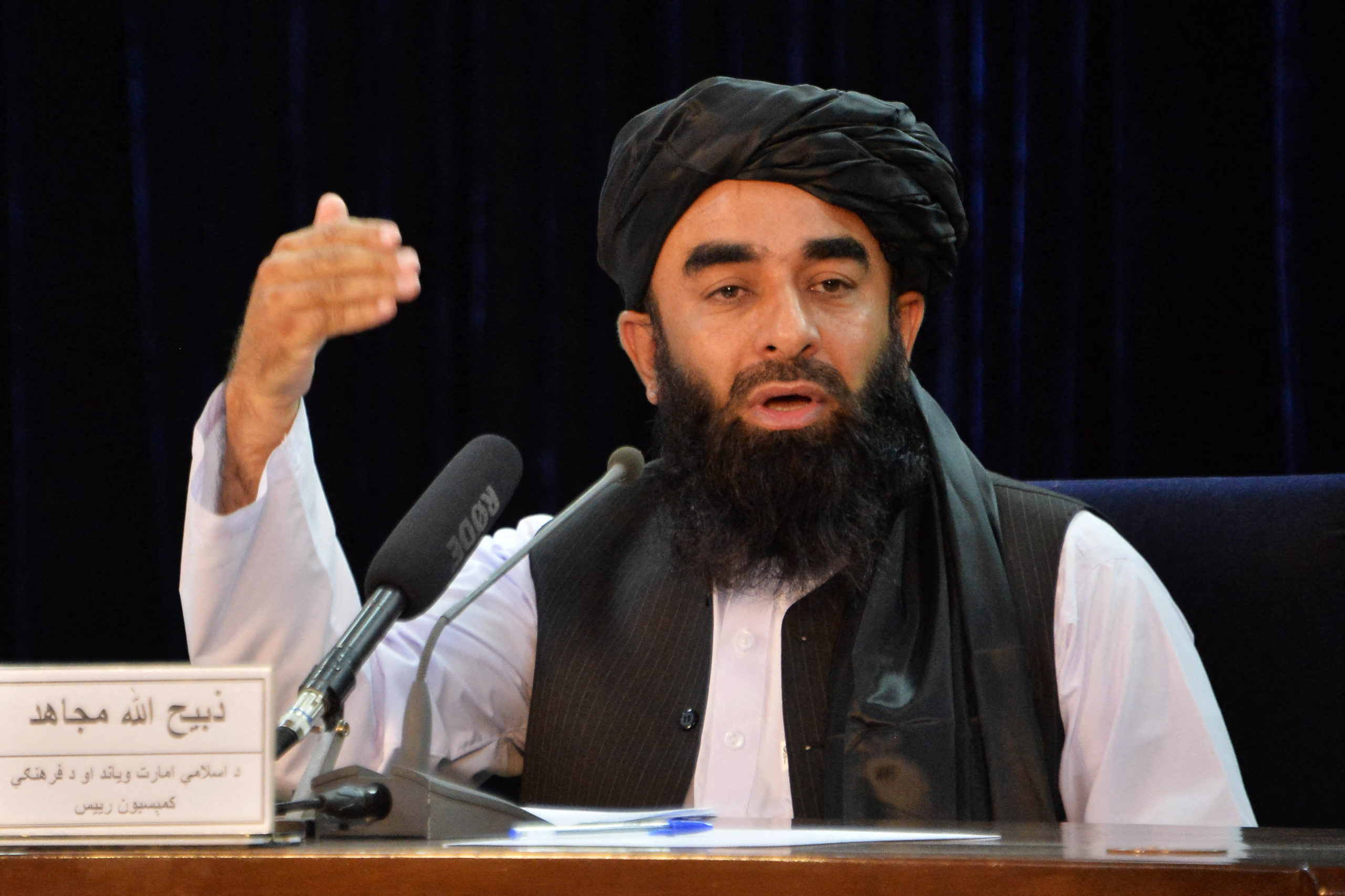 Taliban spokesperson Zabihullah Mujahid gestures as he speaks during a press conference in Kabul on August 24, 2021 after the Taliban stunning takeover of Afghanistan. (Photo by Hoshang Hashimi / AFP) (Photo by HOSHANG HASHIMI/AFP via Getty Images)