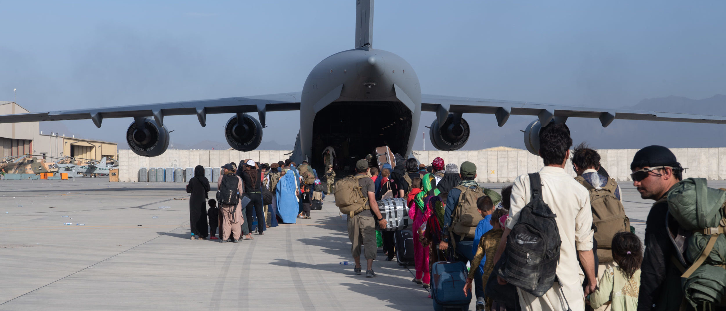 KABUL, AFGHANISTAN - AUGUST 24: In this handout provided by U.S. Central Command Public Affairs, U.S. Air Force loadmasters and pilots assigned to the 816th Expeditionary Airlift Squadron, load passengers aboard a U.S. Air Force C-17 Globemaster III in support of the Afghanistan evacuation at Hamid Karzai International Airport (HKIA) on August 24, 2021 in Kabul, Afghanistan. The United States and allies urged Afghans to leave Kabul airport, citing the threat of terrorist attacks, as Western troops race to evacuate as many people as possible by August 31. (Photo by Master Sgt. Donald R. Allen/U.S. Air Forces Europe-Africa via Getty Images)