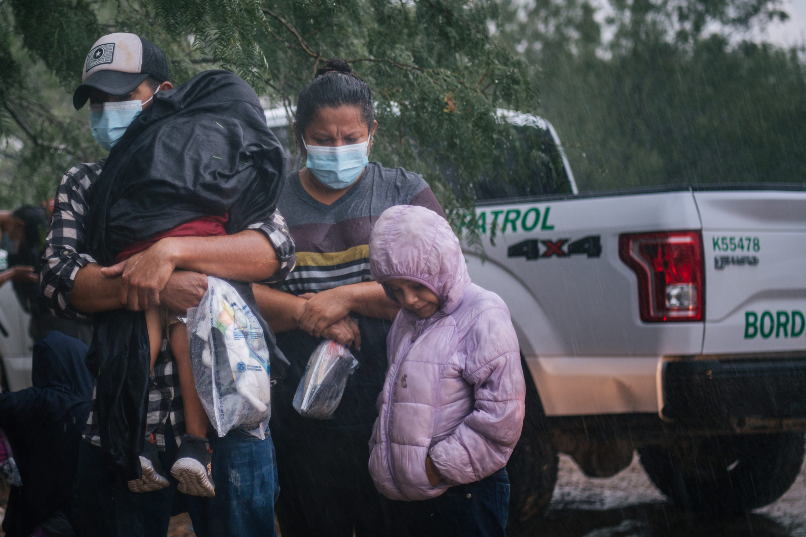 An immigrants family seeking asylum prepares to be taken to a border patrol processing facility after crossing into the U.S. on June 16, 2021 in LaJoya, Texas. (Photo by Brandon Bell/Getty Images)