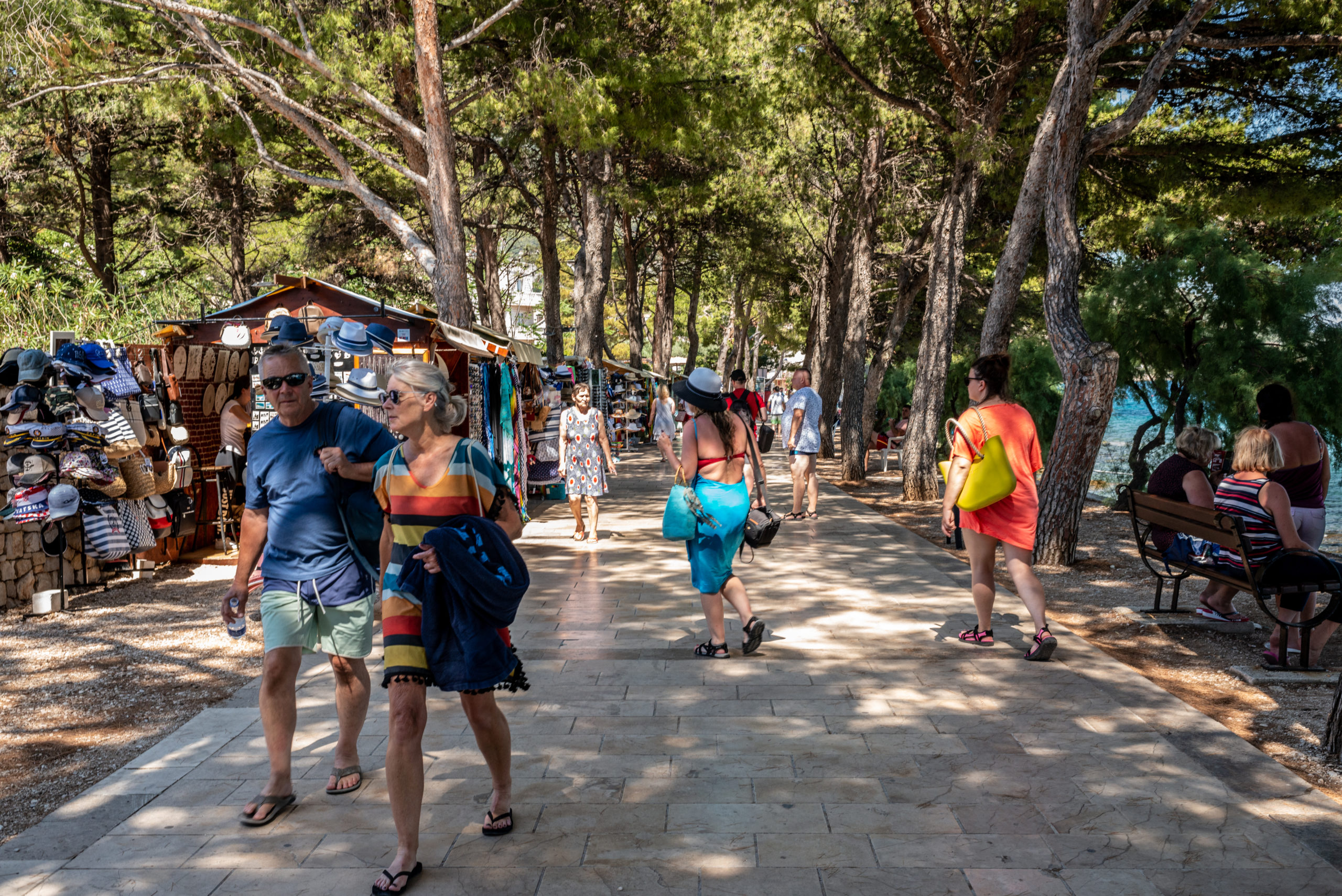 Tourists walk the road under a pinewood to reach the beaches on June 27, 2021 in Bol, Croatia. (Photo by Elisabetta Zavoli/Getty Images)