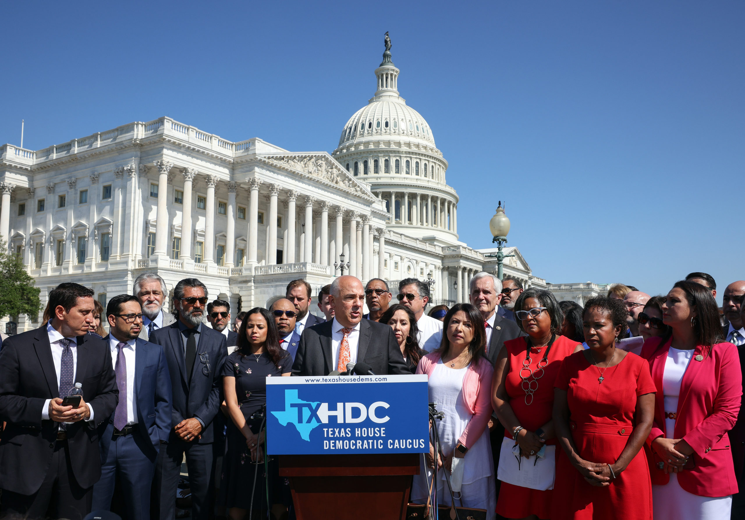 Texas state House Democrats speak outside the U.S. Capitol on July 13 after more than sixty of them fled their home state overnight. (Kevin Dietsch/Getty Images)
