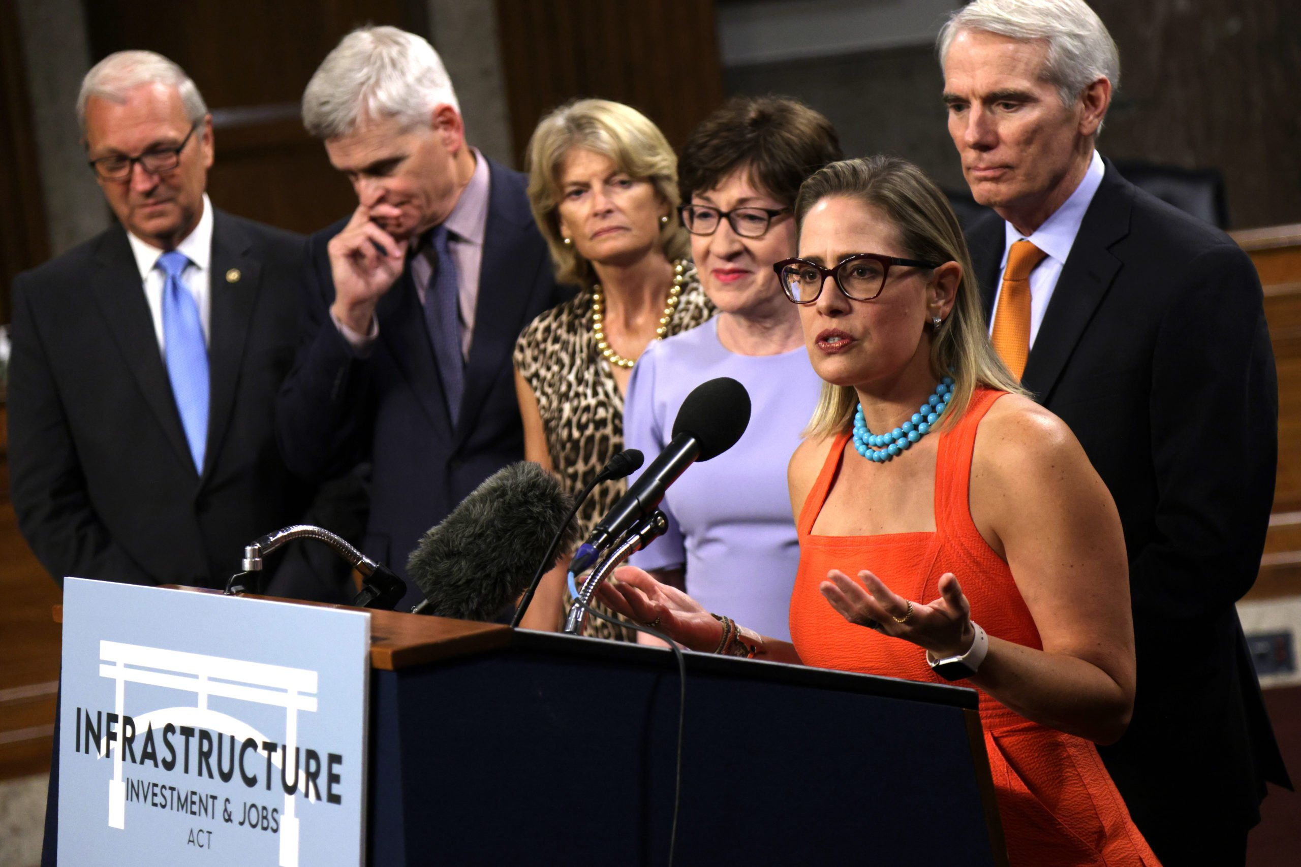 Sen. Kyrsten Sinema speaks after the bipartisan bill cleared its first procedural vote in July. (Alex Wong/Getty Images)
