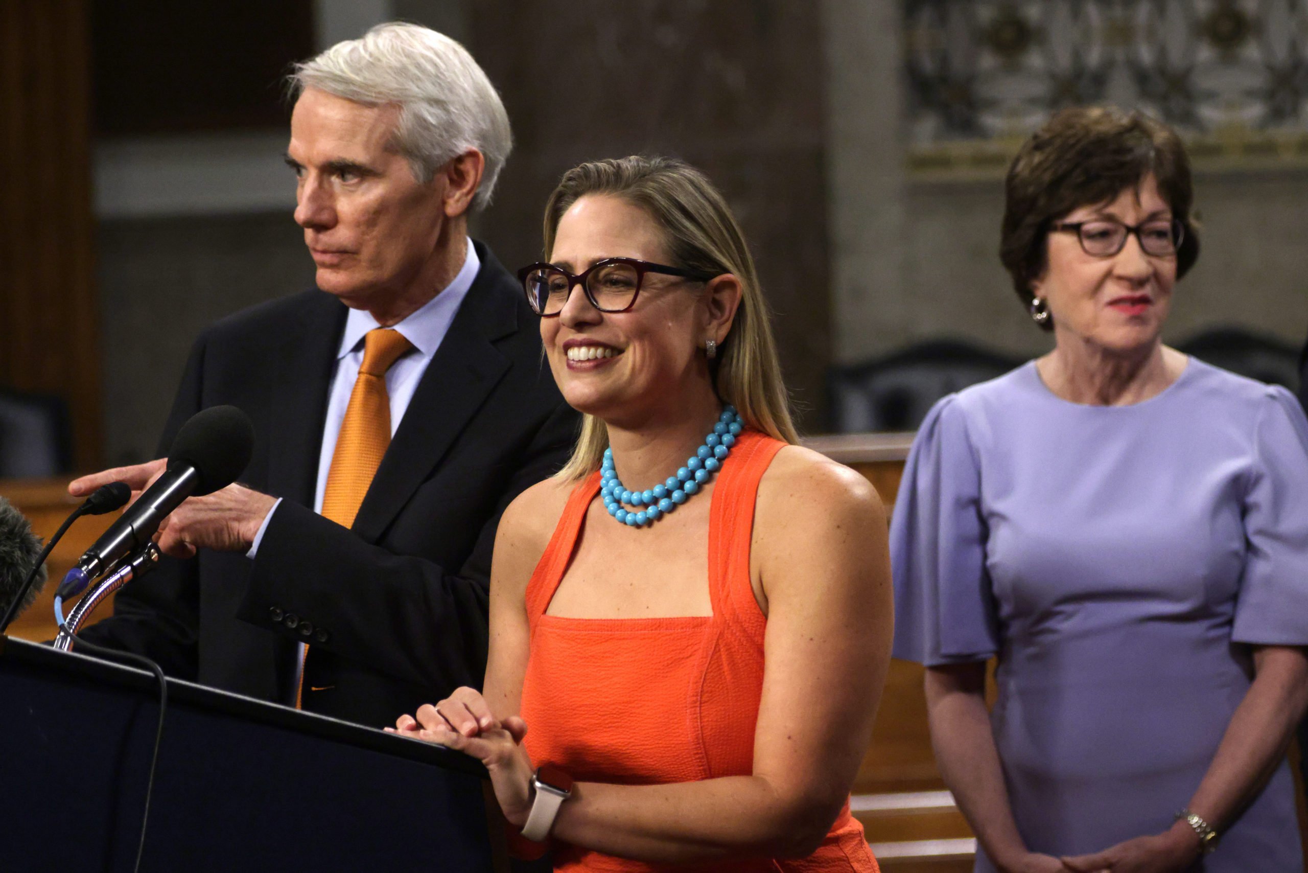 Sens. Rob Portman, Kyrsten Sinema and Susan Collins during a news conference Thursday on Capitol Hill. (Alex Wong/Getty Images)
