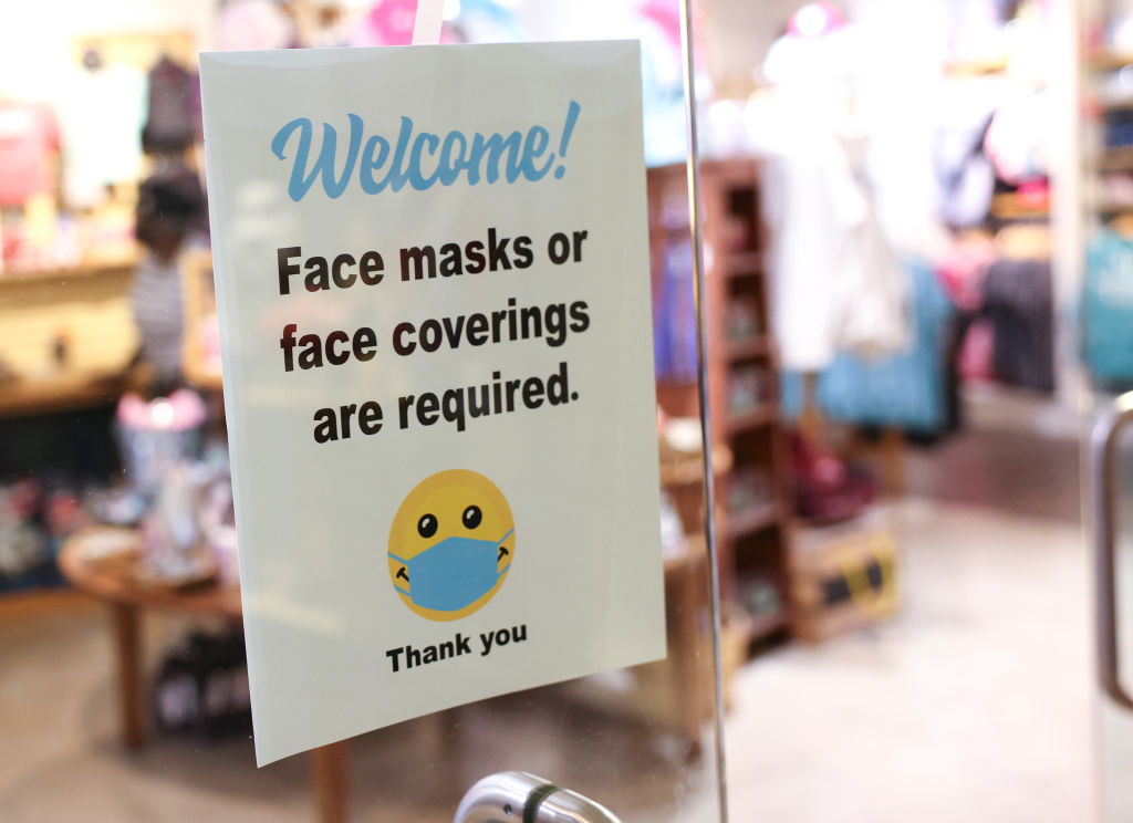 WASHINGTON, DC - JULY 30: A sign requiring mask use is seen outside of a store in Union Station on July 30, 2021 in Washington, DC. DC Mayor Muriel Bowser restored a COVID-19 indoor mask mandate, regardless of vaccination status, starting Saturday. (Photo by Kevin Dietsch/Getty Images)