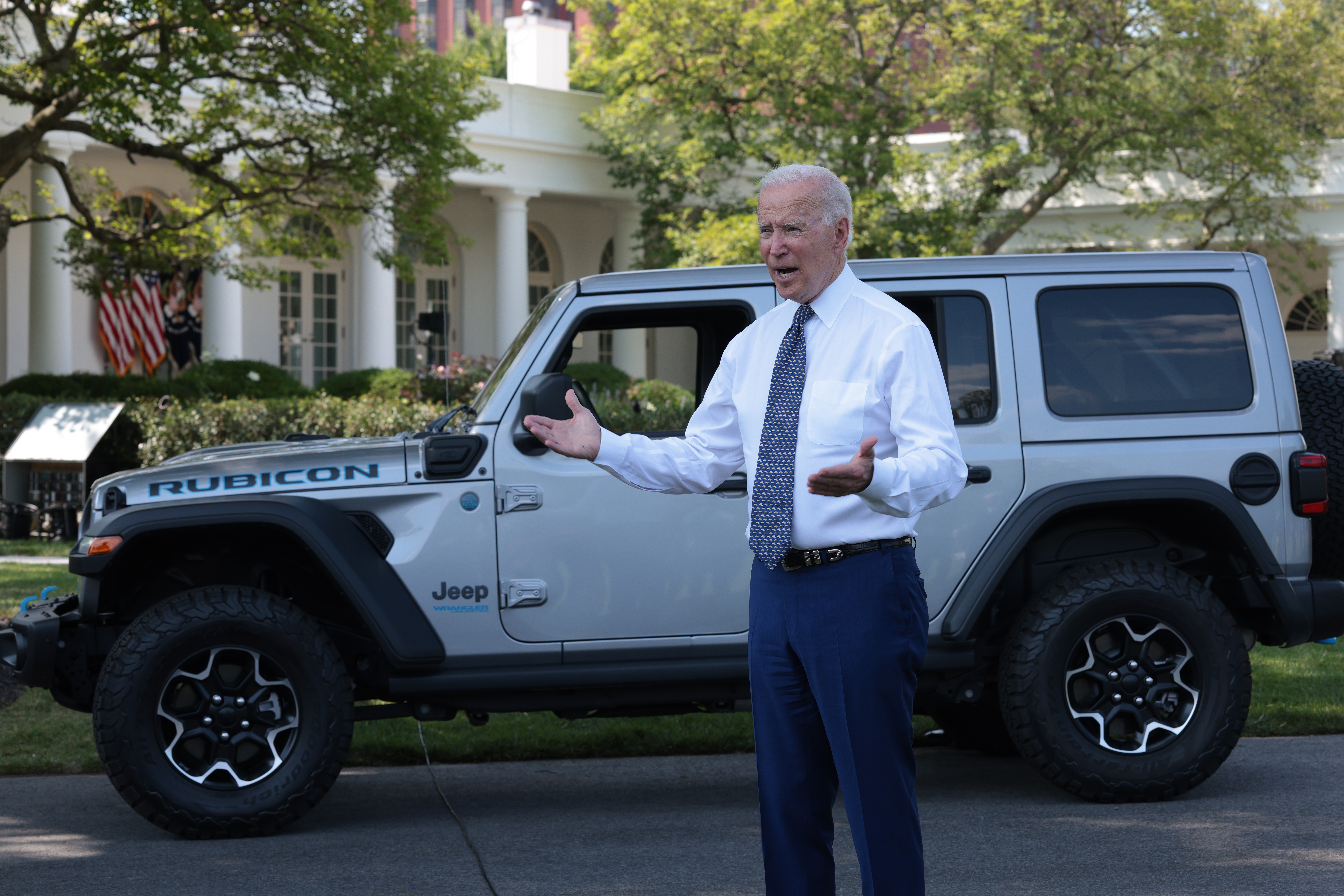 President Joe Biden answers questions from reporters after driving a Jeep around the White House on Thursday. (Win McNamee/Getty Images)