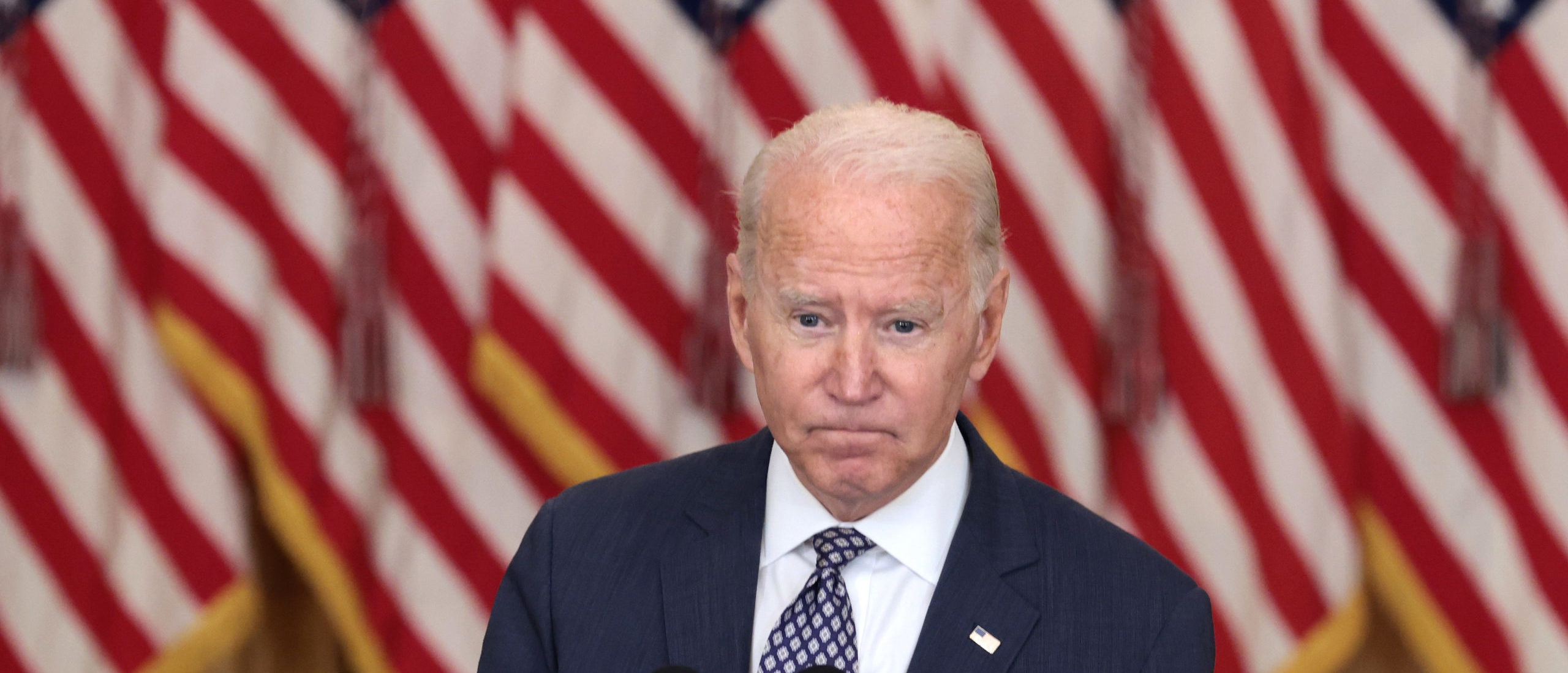 U.S. President Joe Biden gestures as delivers remarks on the U.S. military's ongoing evacuation efforts in Afghanistan from the East Room of the White House on August 20, 2021 in Washington, DC. The White House announced earlier that the U.S. has evacuated almost 14,000 people from Afghanistan since the end of July. (Photo by Anna Moneymaker/Getty Images)