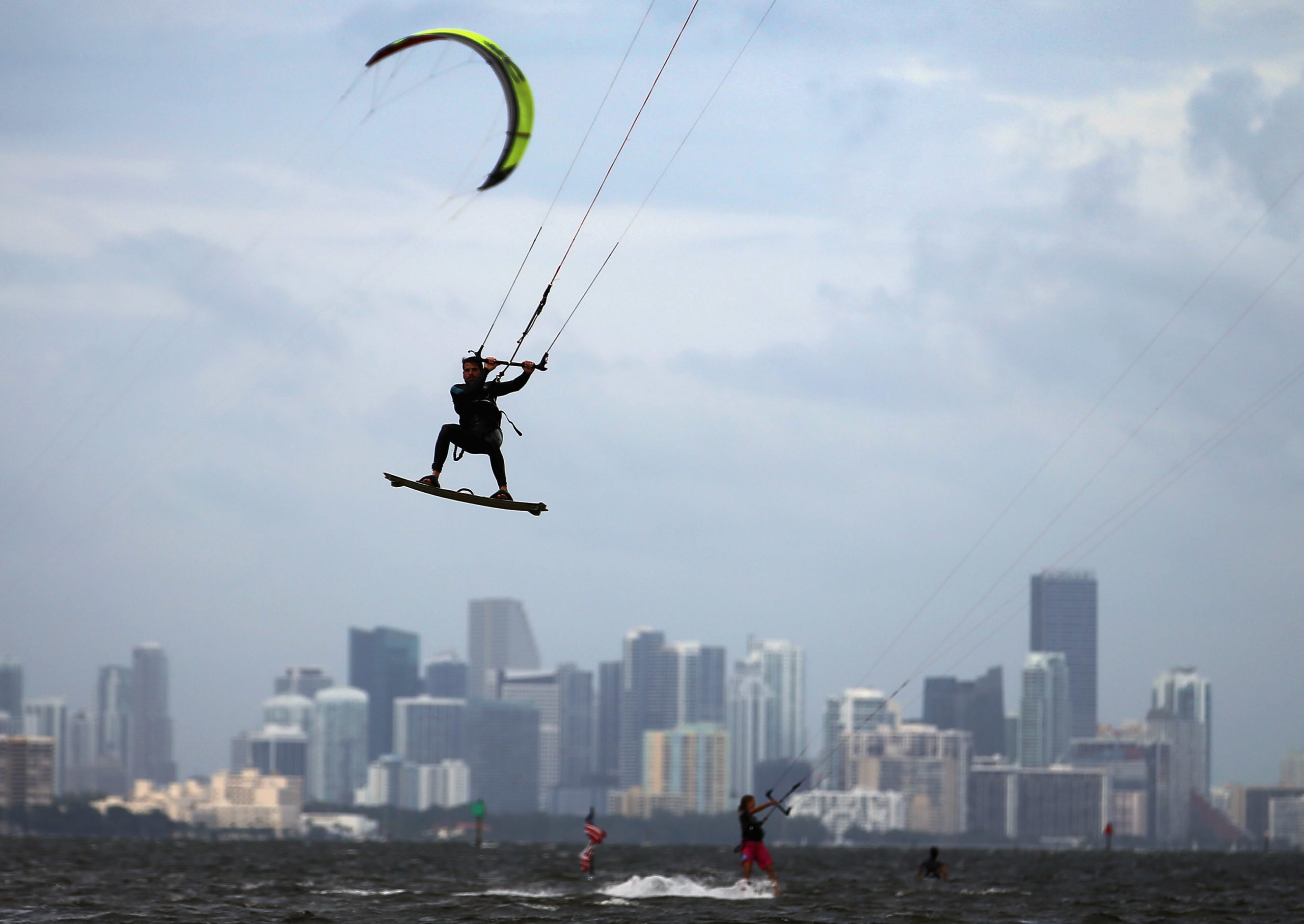 Santiago Porteiro takes advantage of the winds from the outerbands of Hurricane Sandy to kite surf on October 24, 2012 in Miami, Florida. (Photo by Joe Raedle/Getty Images)