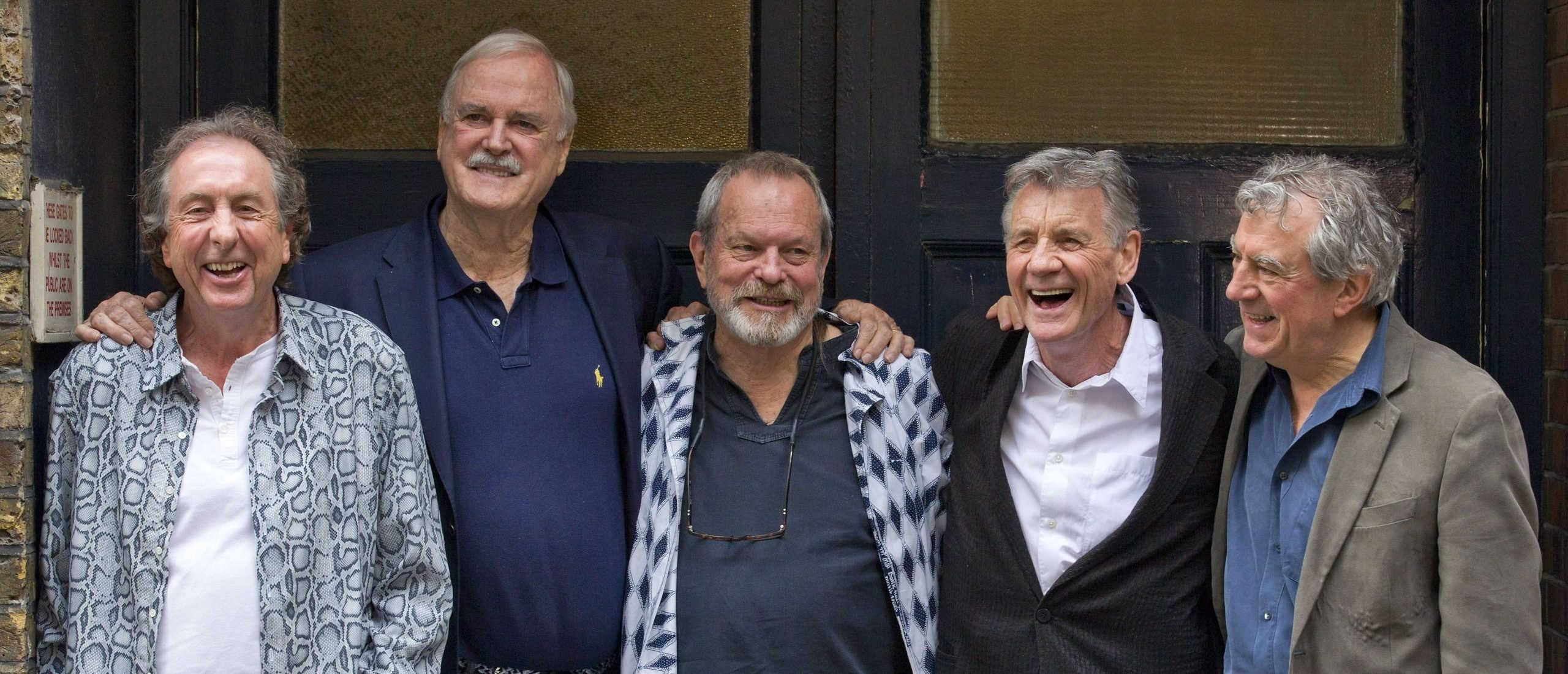 (FILES) IN this file picture taken on June 30, 2014 British comedy troupe Monty Python, (L-R) Eric Idle, John Cleese, Terry Gilliam, Michael Palin, and Terry Jones pose for a photograph at the back door to the London Palladium in central London. The return of Monty Python received largely kind reviews from British newspapers on July 2, 2014, which said the ageing comedians' comeback kept devotees looking on the bright side even if it might not win new fans. AFP PHOTO/JUSTIN TALLIS (Photo credit should read JUSTIN TALLIS/AFP via Getty Images)