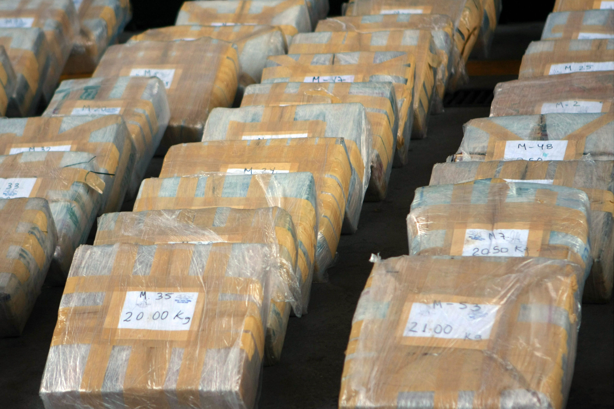 Picture of packages containing around 1,500 kilos of cocaine presented to the press by Peru's National Police Anti-Drug Directorate (DIRANDRO) on March 10, 2008. (Photo credit should read ERNESTO BENAVIDES/AFP via Getty Images)