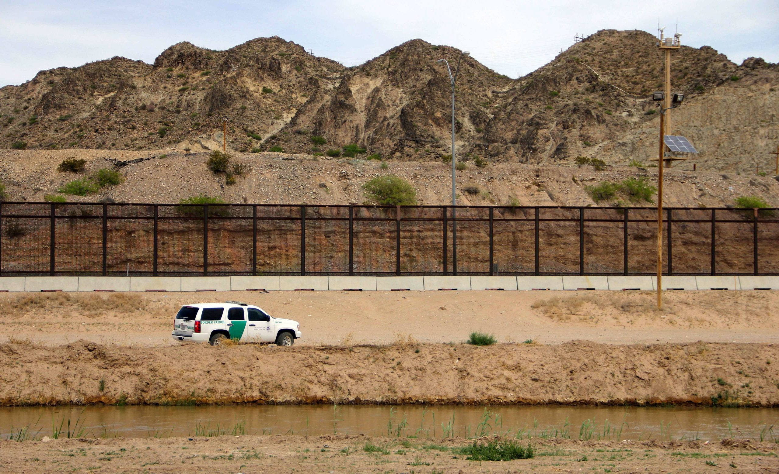 A US Border Patrol is seen from Mexico while patrolling along the border line between the cities of El Paso, Texas, in the United States, and Ciudad Juarez, Chihuahua state, Mexico on April 7, 2018. The US states of Texas and Arizona on Friday announced plans to send National Guard troops to the southern border with Mexico after President Donald Trump ordered a thousands-strong deployment to combat drug trafficking and illegal immigration. / AFP PHOTO / HERIKA MARTINEZ (Photo credit should read HERIKA MARTINEZ/AFP via Getty Images)