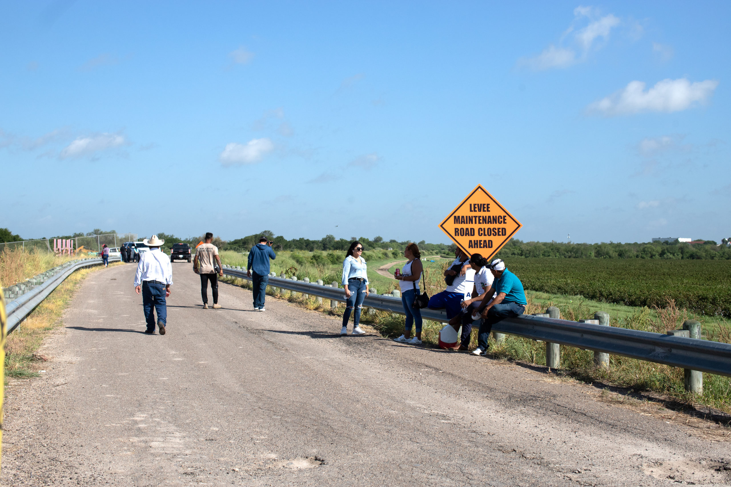 Around two dozen people waited at the endge of Anzalduas Park to pick up friends and family members who tested positive for COVID-19 after entering the U.S. illegally in Mission, Texas, on August 8, 2021. (Kaylee Greenlee - Daily Caller News Foundation)