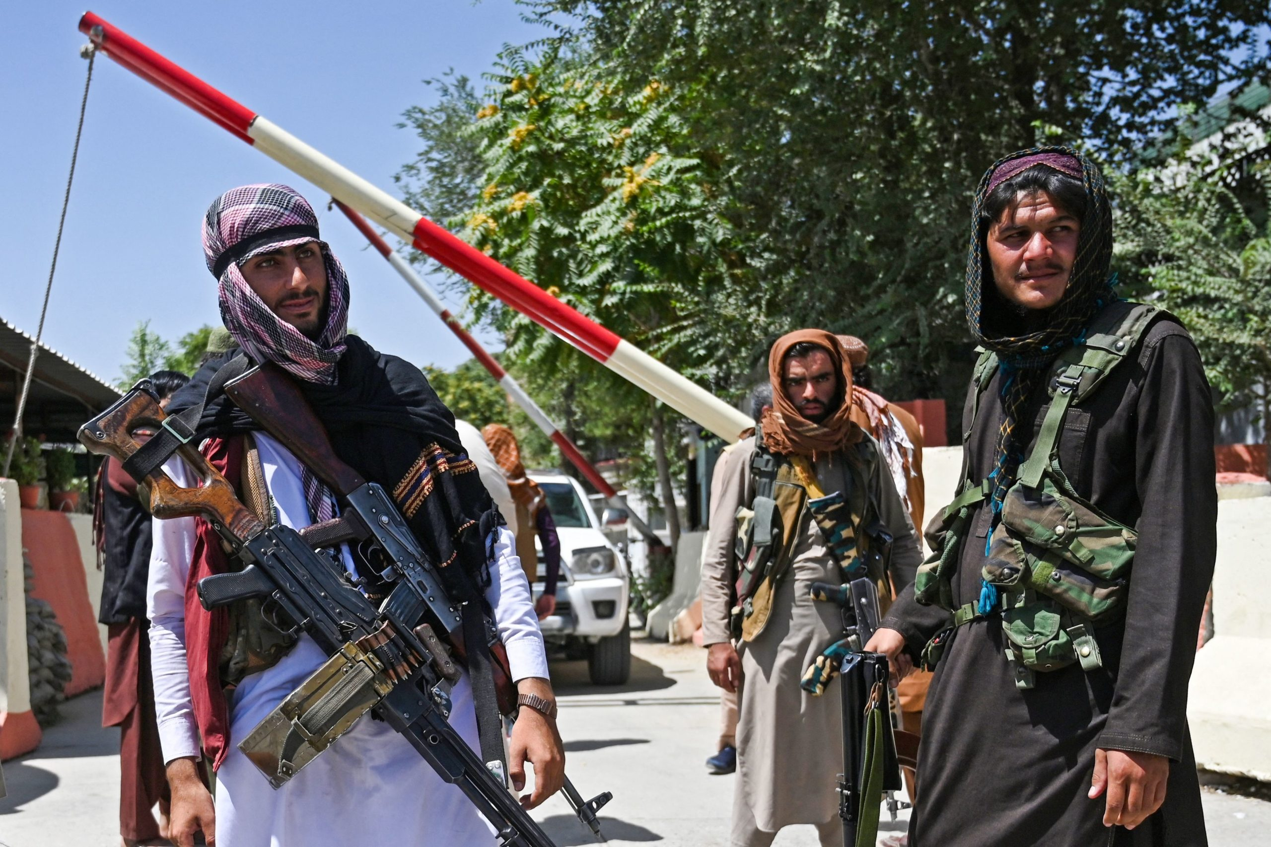 Taliban fighters stand guard along a roadside near the Zanbaq Square in Kabul on August 16, 2021, after a stunningly swift end to Afghanistan's 20-year war, as thousands of people mobbed the city's airport trying to flee the group's feared hardline brand of Islamist rule. (Photo by WAKIL KOHSAR/AFP via Getty Images)
