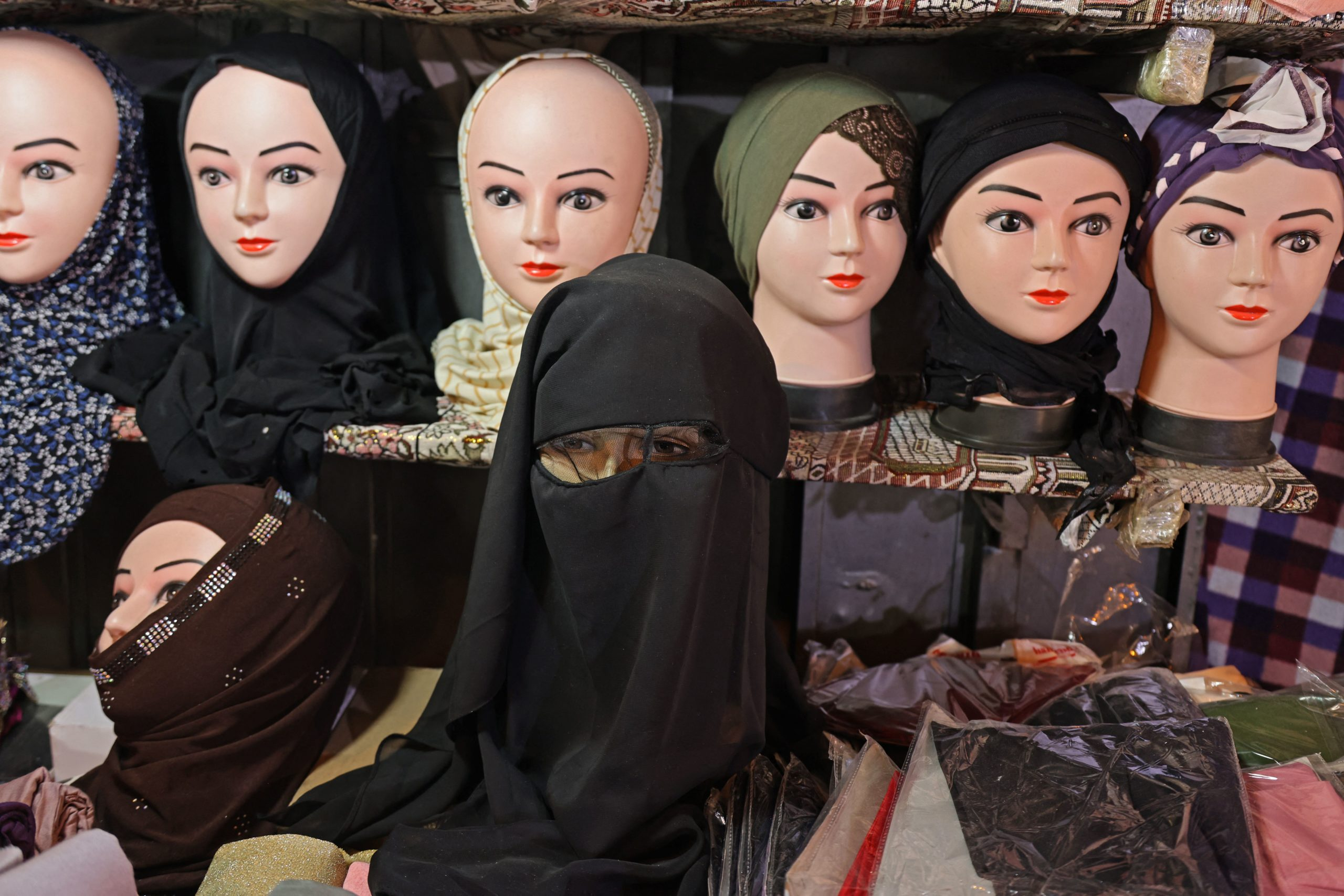 A picture taken at a shop in Jerusalem's Old City on May 14, 2021 shows Muslim headdresses, including a nikab full face cover. (Photo by Ahmad GHARABLI / AFP) (Photo by AHMAD GHARABLI/AFP via Getty Images)