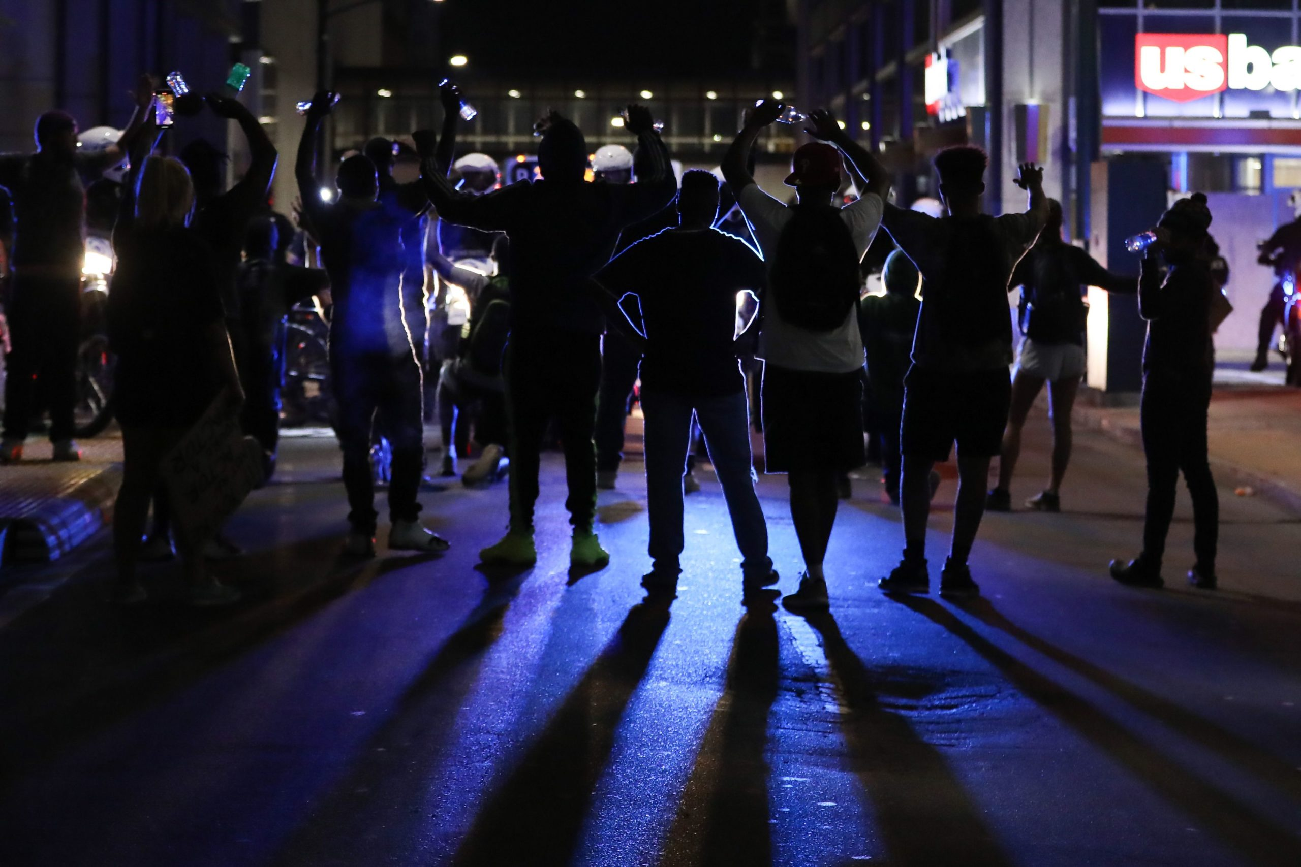 Protestors block the path of CMPD officers as they attempt to make an arrest near uptown Charlotte, North Carolina on June 2, 2020. (Photo by LOGAN CYRUS/AFP via Getty Images)