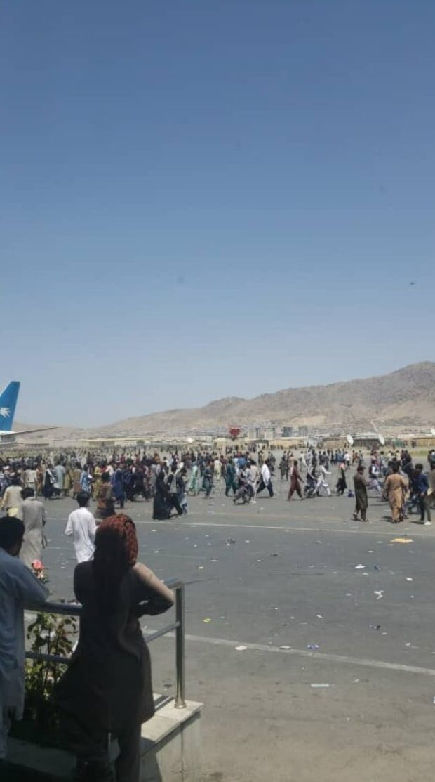 Afghans Wait On The Civilian Side Of The Airport