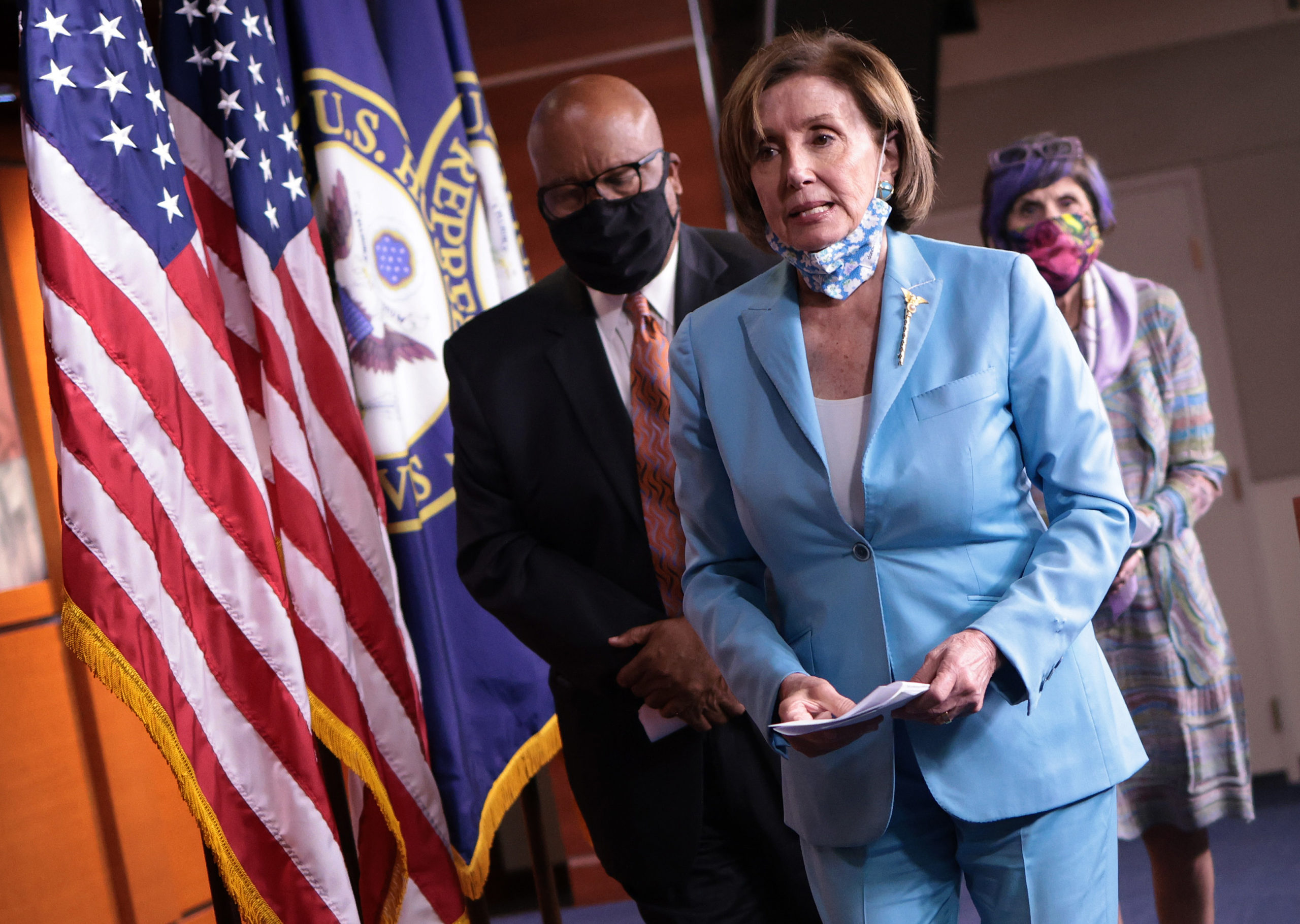 U.S. Speaker of the House Nancy Pelosi, trailed by Rep. Bennie Thompson and Rep. Rosa DeLauro, departs a press conference on the establishment of a commission to investigate the events surrounding January 6 at the U.S. Capitol on May 19, 2021 in Washington, DC. (Photo by Win McNamee/Getty Images)