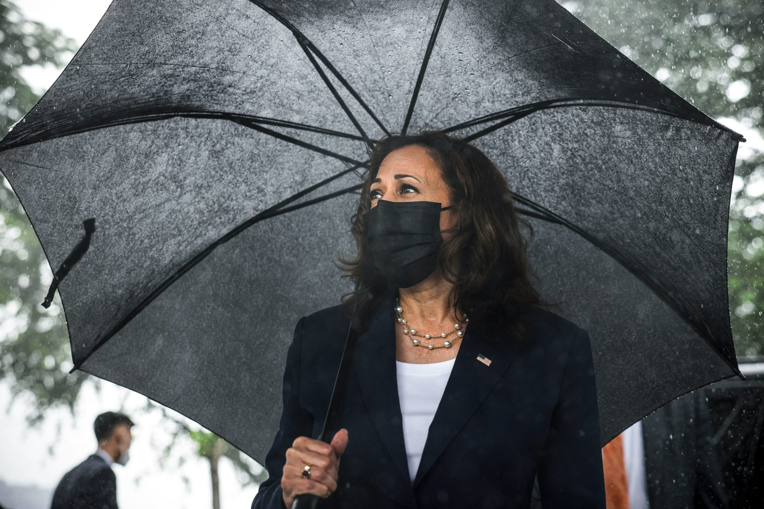 U.S. Vice President Kamala Harris looks on as she lays flowers at the Senator John McCain memorial site, where his Navy aircraft was shot down by the North Vietnamese, on the three-year anniversary of his death, in Hanoi on August 25, 2021. (Photo by EVELYN HOCKSTEIN/POOL/AFP via Getty Images)