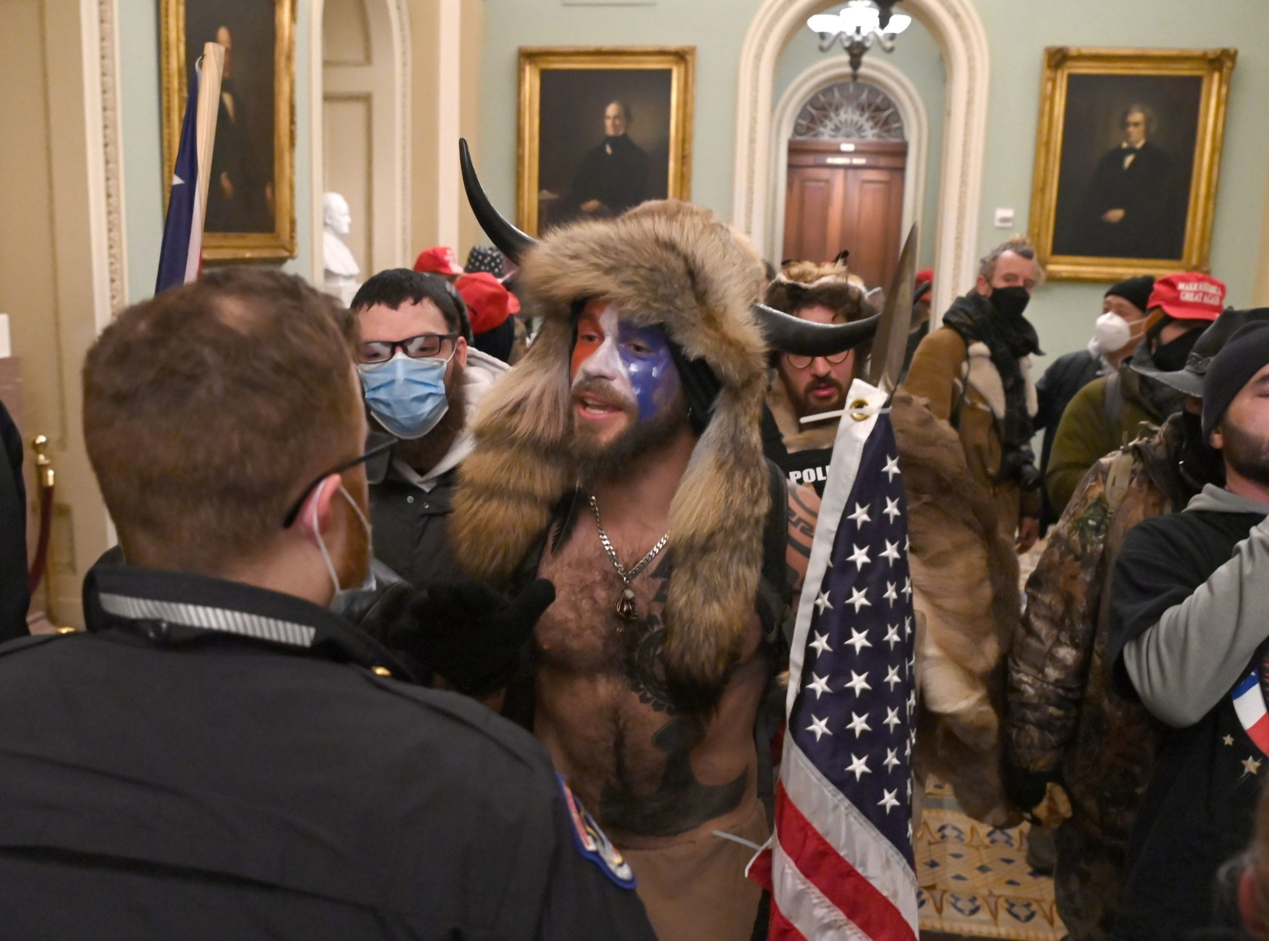 Capitol rioters confront a police officer on January 6, 2021. (Photo by SAUL LOEB/AFP via Getty Images)