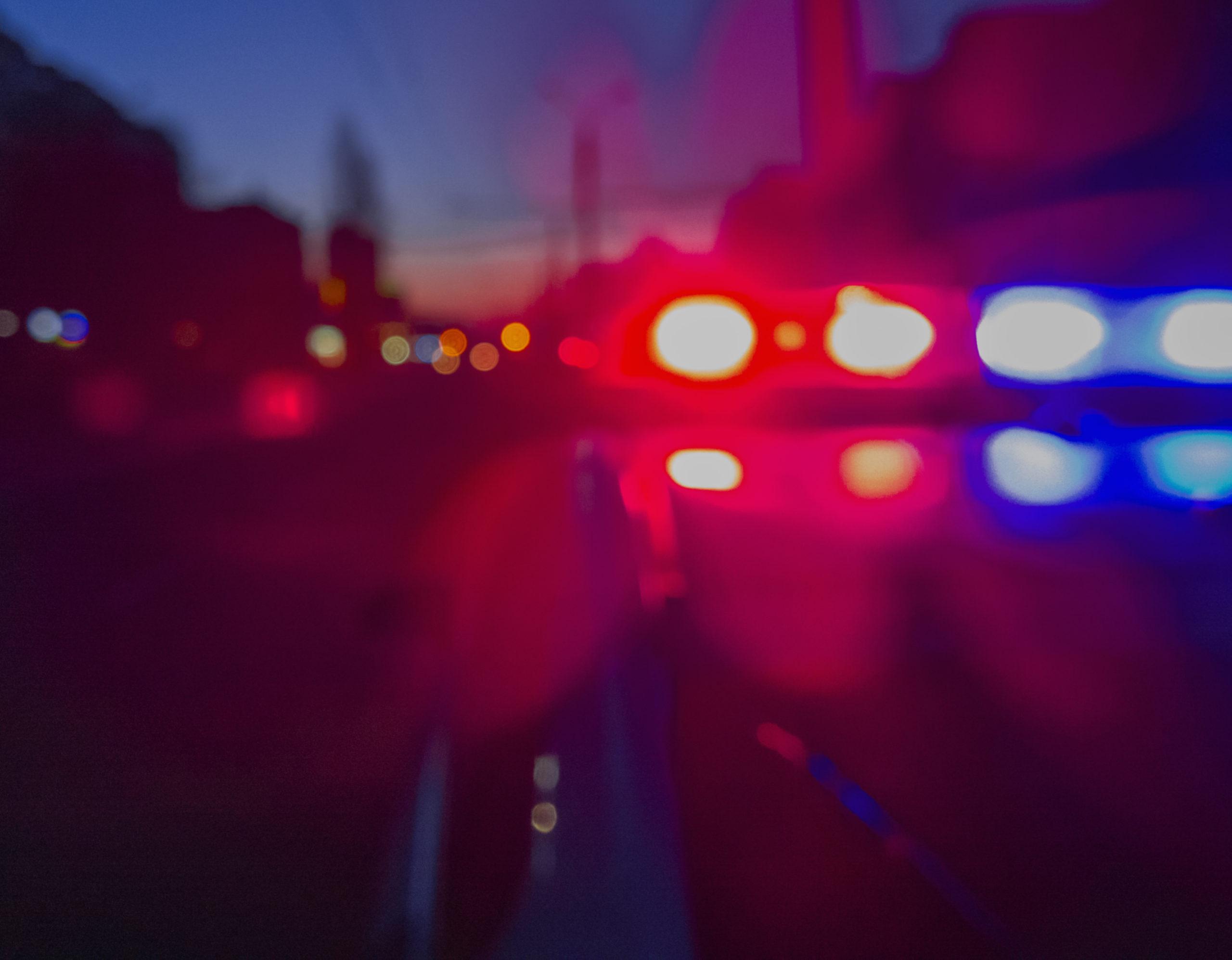 Red and blue police lights. [Yevhen Prozhyrko/Shutterstock]