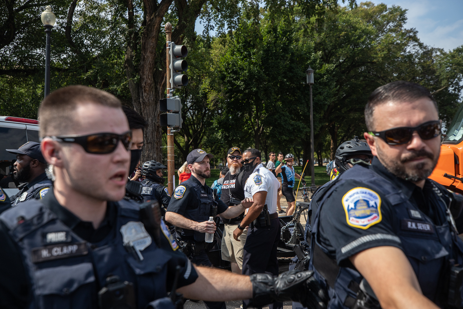 Law enforcement officials escorted a man who got into a shouting match with protesters at the
