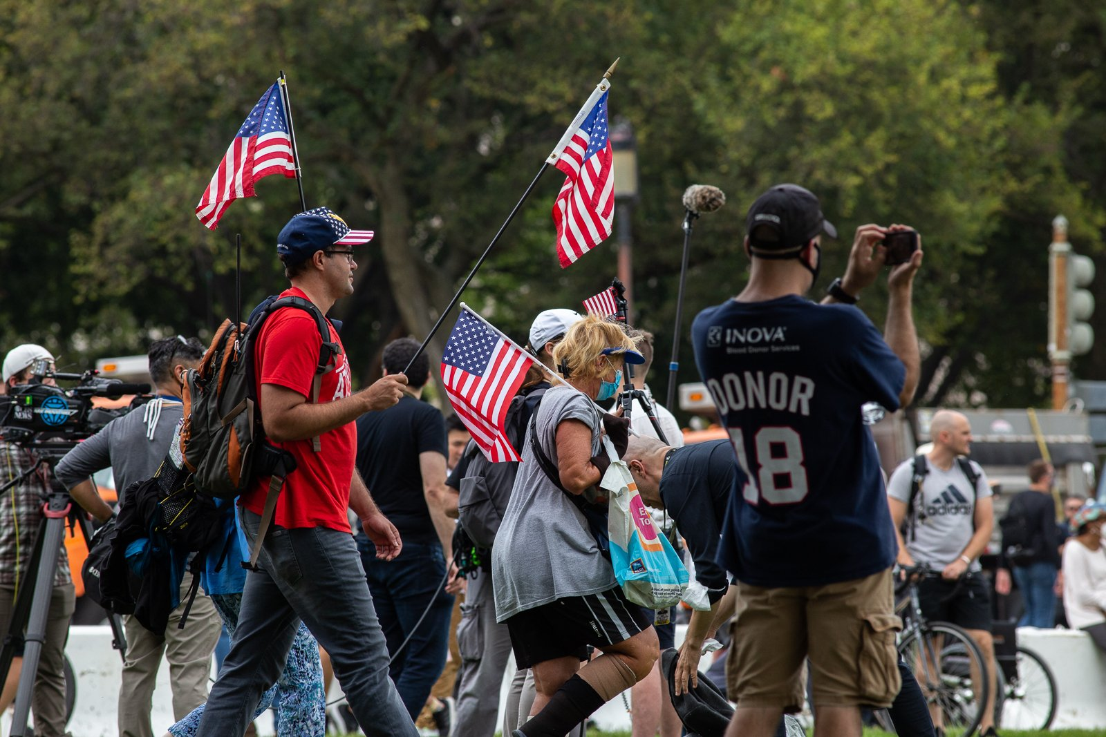"""Several people carried American flags and signs in support of people jailed in connection with the Capitol riot at the """"Justice for J6"""" rally in Washington, D.C. on September 18, 2021. (Kaylee Greenlee – Daily Caller News Foundation)"""