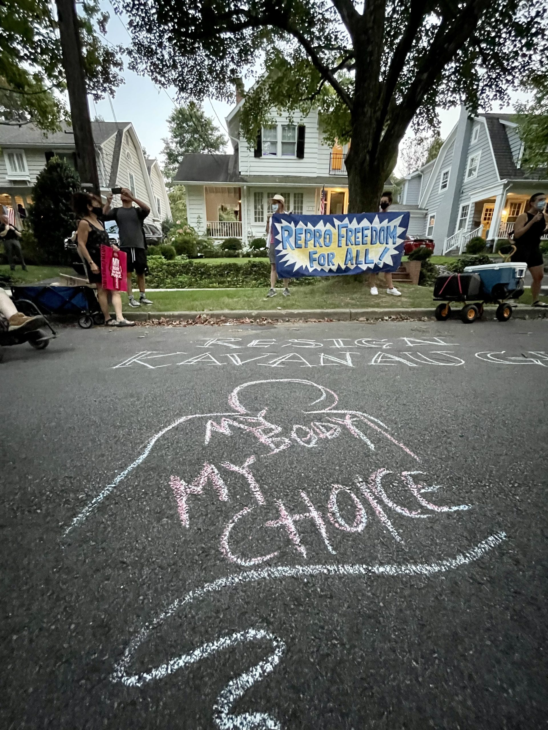 """Protestors wrote """"Resign Kavanaugh"""" in chalk in front of the Supreme Court justice's house. Police washed the chalk writing away with water after the protest. Photo by the Daily Caller News Foundation."""