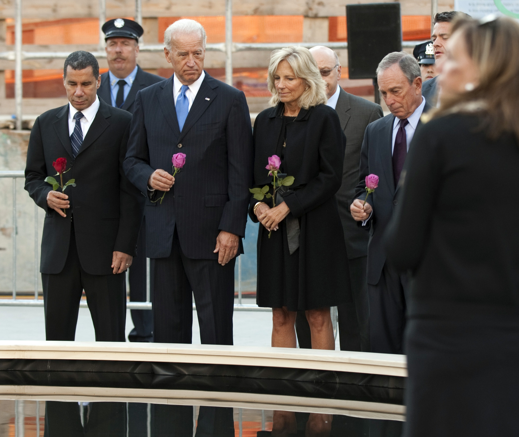 US Vice President Joe Biden (2nd L) and his wife Dr. Jill Biden (2nd R), with New York Governor David Paterson (L) and New York City Mayor Michael Bloomberg,e place flowers at the relecting pool at the World Trade Center site on September 11, 2010 in New York for the ninth anniversary commemoration ceremony of the terrorist attacks. POOL/DON EMMERT (Photo credit should read DON EMMERT/AFP via Getty Images)