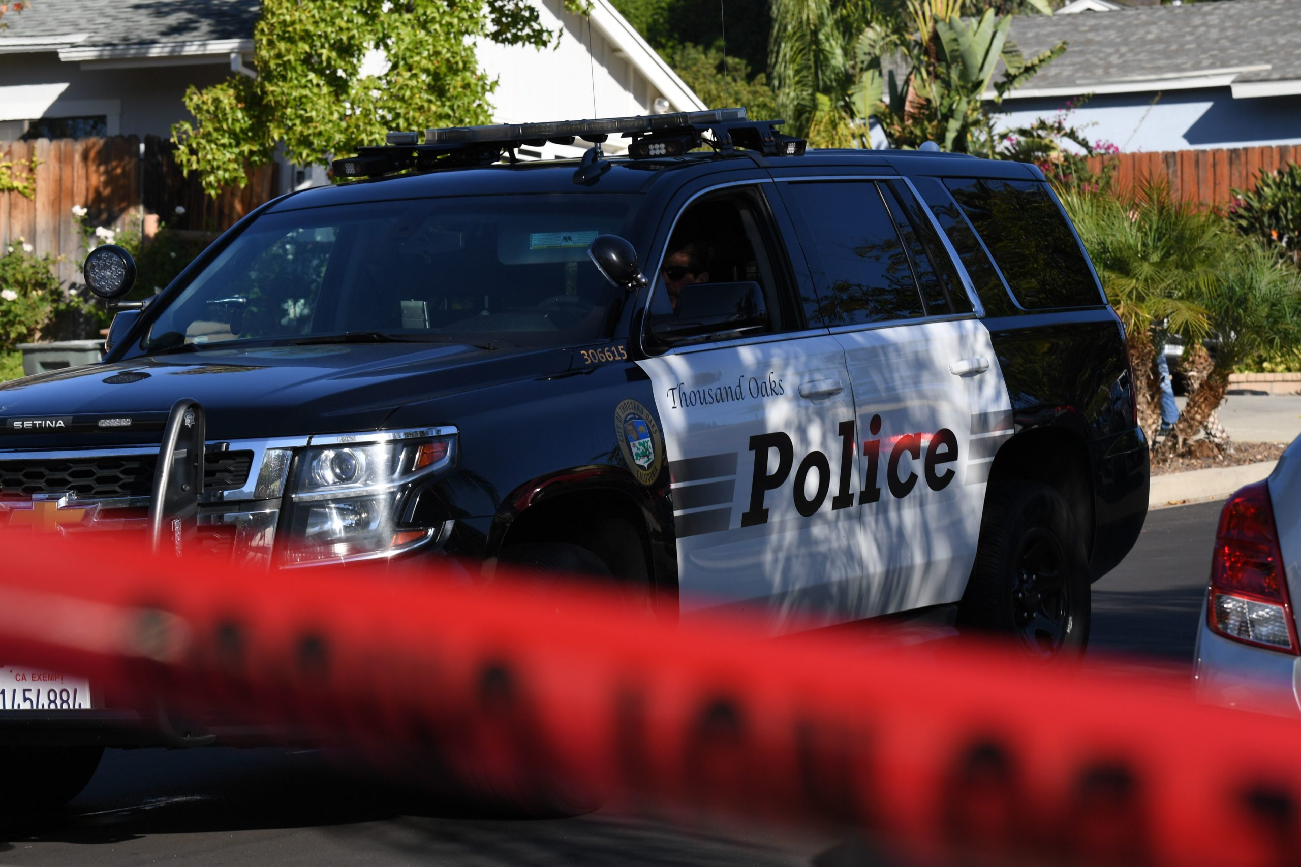 Police provide security as the home of suspected nightclub shooter Ian David Long is cordoned with red crime tape on November 8 2018, in Thousand Oaks, California, as FBI and ATF officers conduct a search. - The gunman who killed 12 people in a crowded California country music bar has been identified as 28-year-old Ian David Long, a former Marine, the local sheriff said Thursday. The suspect, who was armed with a .45-caliber handgun, was found deceased at the Borderline Bar and Grill, the scene of the shooting in the city of Thousand Oaks northwest of downtown Los Angeles. (Photo by Robyn Beck / AFP) (Photo by ROBYN BECK/AFP via Getty Images)