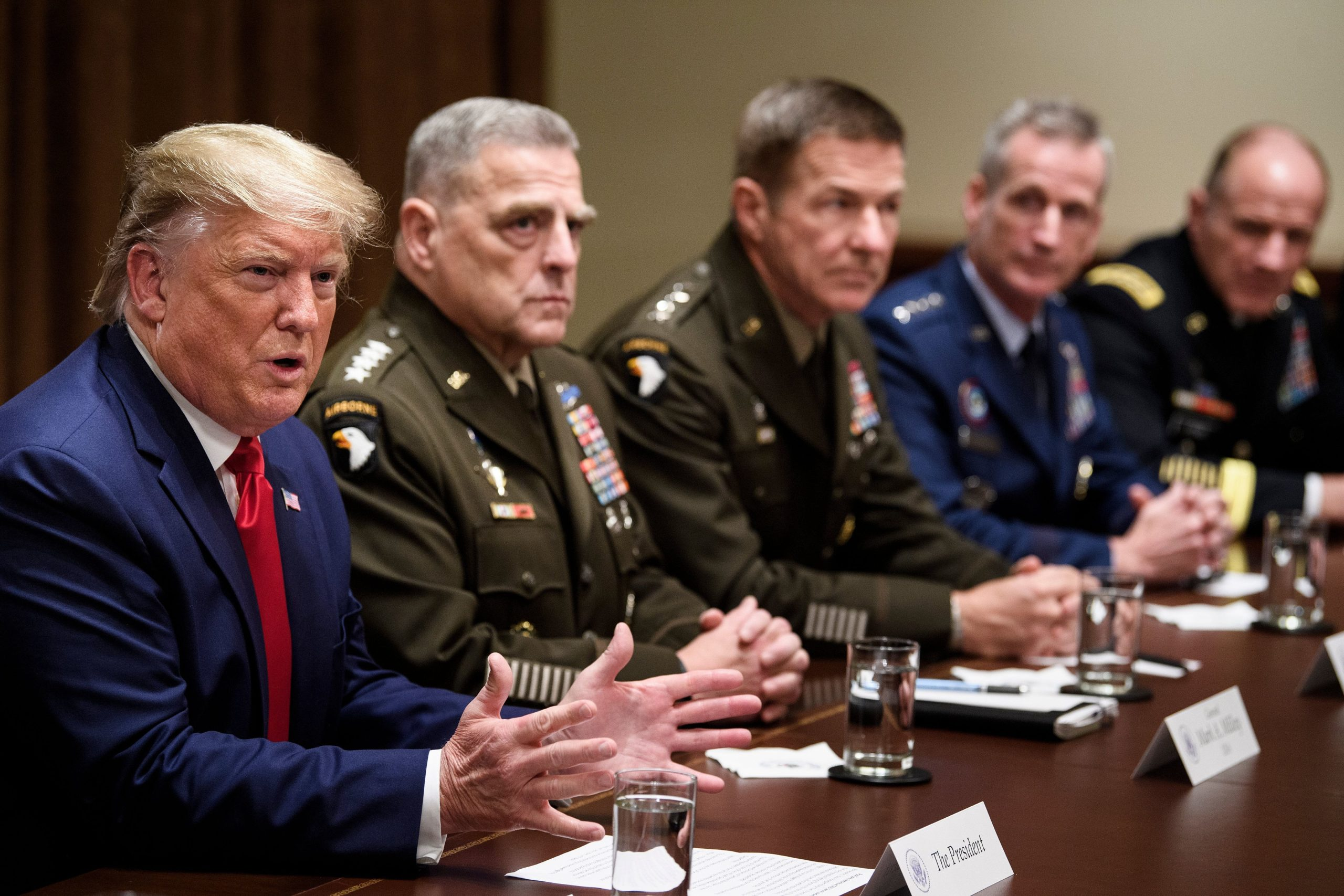 Chairman of the Joint Chiefs of Staff Army General Mark A. Milley (2nd L) and others listen as US President Donald Trump speaks during a meeting with senior military leaders in the Cabinet Room of the White House October 7, 2019, in Washington, DC. (Photo by Brendan Smialowski / AFP) (Photo by BRENDAN SMIALOWSKI/AFP via Getty Images)
