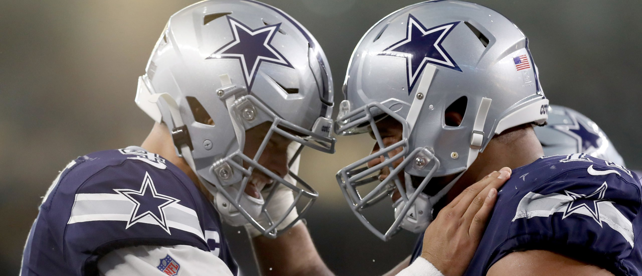 ARLINGTON, TEXAS - DECEMBER 15: Dak Prescott #4 of the Dallas Cowboys celebrates with La'el Collins #71 of the Dallas Cowboys after the Dallas Cowboys scored a touchdown against the Los Angeles Rams in the second quarter at AT&T Stadium on December 15, 2019 in Arlington, Texas. (Photo by Tom Pennington/Getty Images)