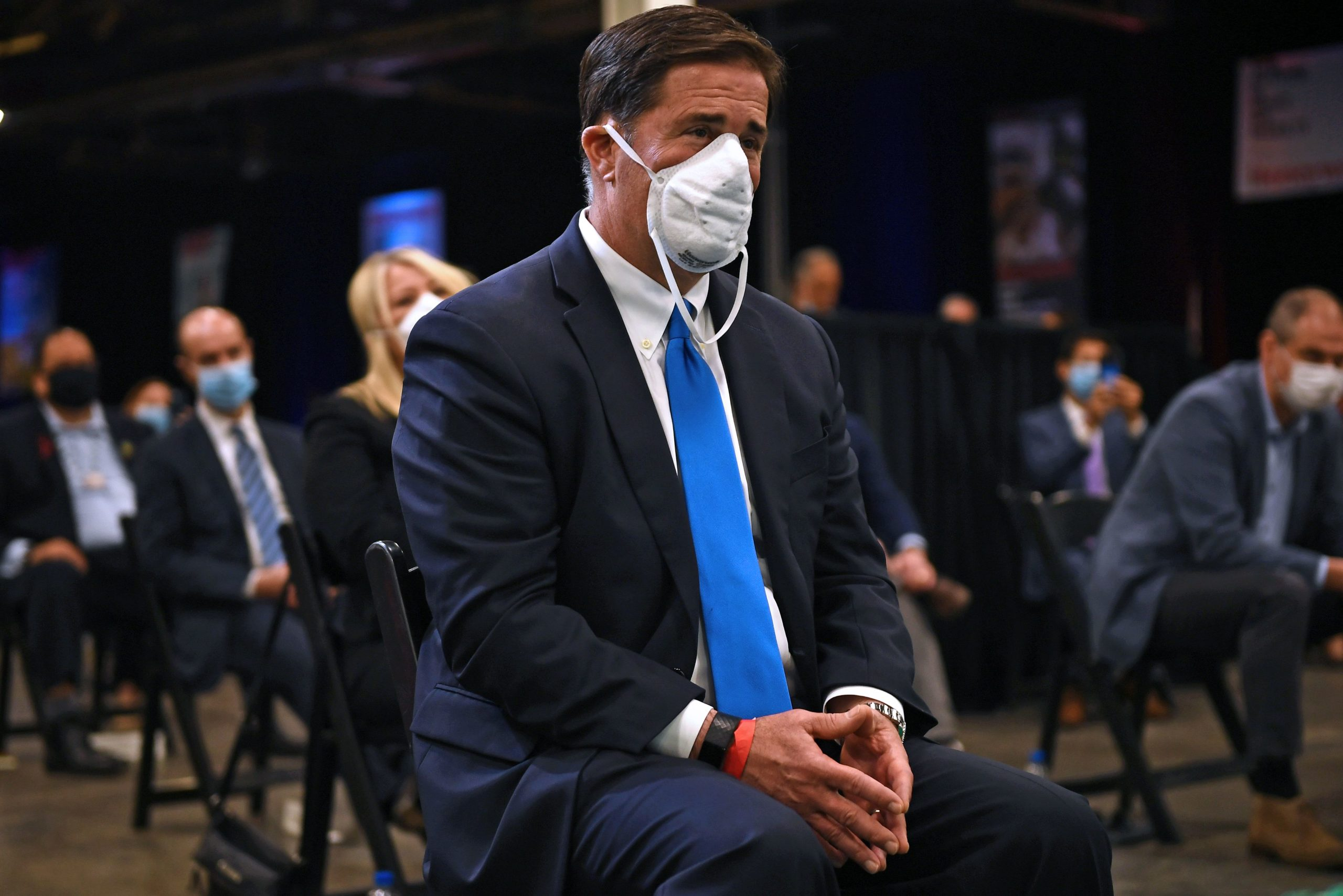 Arizona Gov. Doug Ducey wears a mask as he listens to former President Donald Trump speak in May 2020. (Brendan Smialowski/AFP via Getty Images)