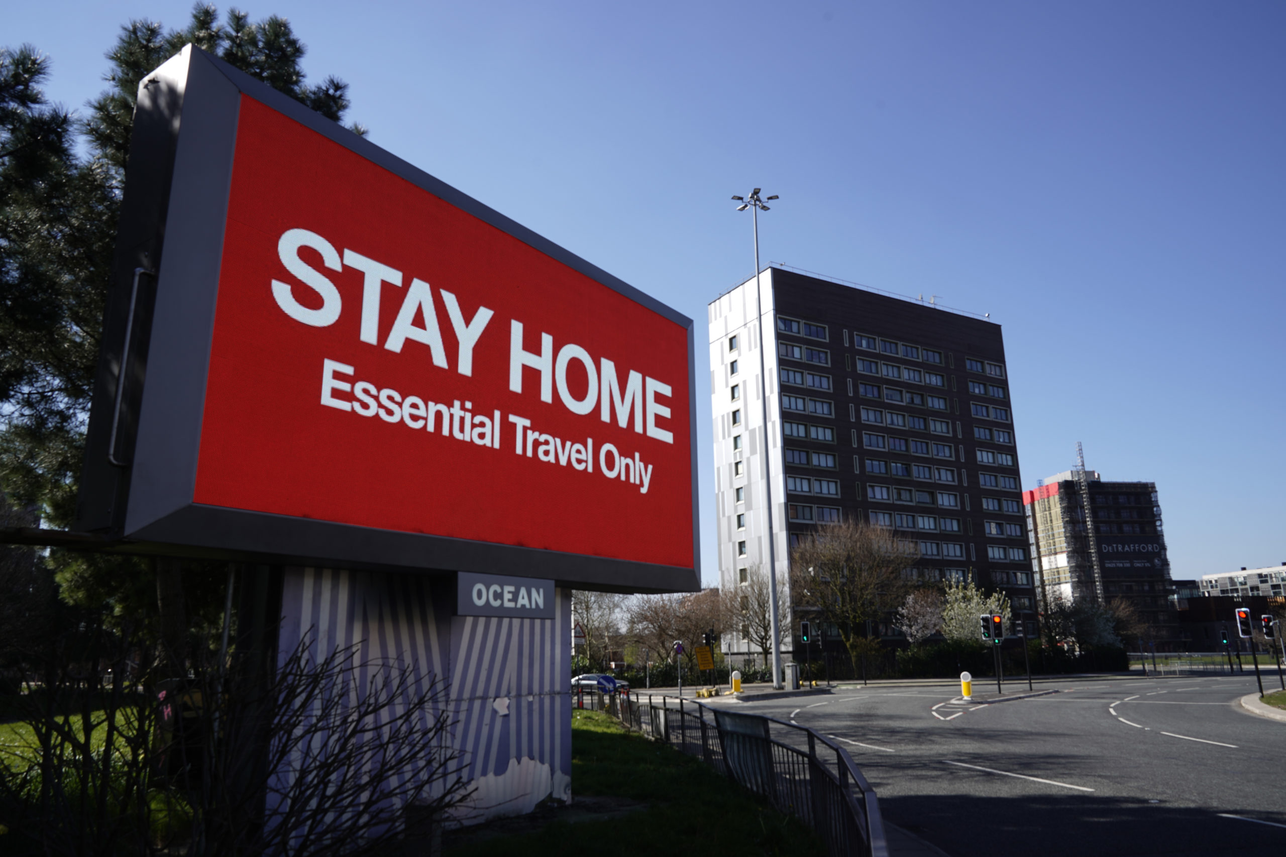 MANCHESTER, - MARCH 26: A giant television over the A57 Motorway urges people to stay home on March 26, 2020 in Manchester, England. British Prime Minister, Boris Johnson, announced strict lockdown measures urging people to stay at home and only leave the house for basic food shopping, exercise once a day and essential travel to and from work. The Coronavirus (COVID-19) pandemic has spread to at least 182 countries, claiming over 10,000 lives and infecting hundreds of thousands more. (Photo by Christopher Furlong/Getty Images)