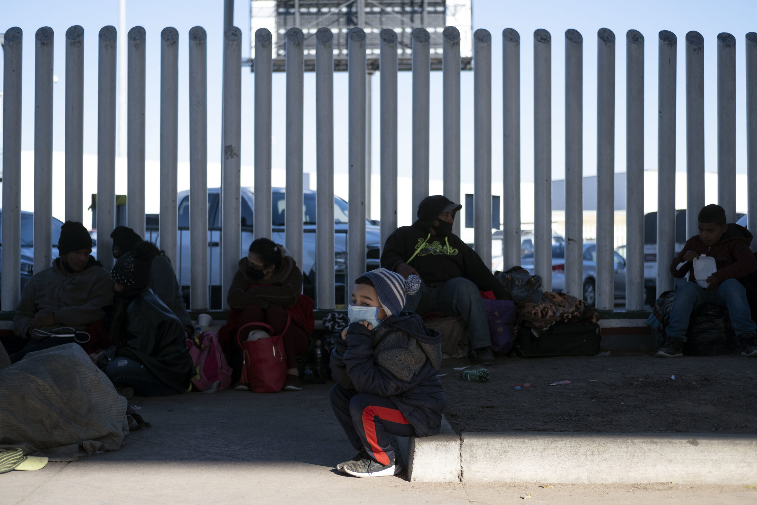 Asylum seekers wait outside El Chaparral crossing port as they try to cross to the United States in Tijuana, Baja California state, Mexico on February 19, 2021. - Hundreds of asylum-seekers were waiting nervously on the US-Mexican border Friday, praying that they would be allowed entry as part of President Joe Biden's immigration reforms. (Photo by Guillermo Arias / AFP) (Photo by GUILLERMO ARIAS/AFP via Getty Images)