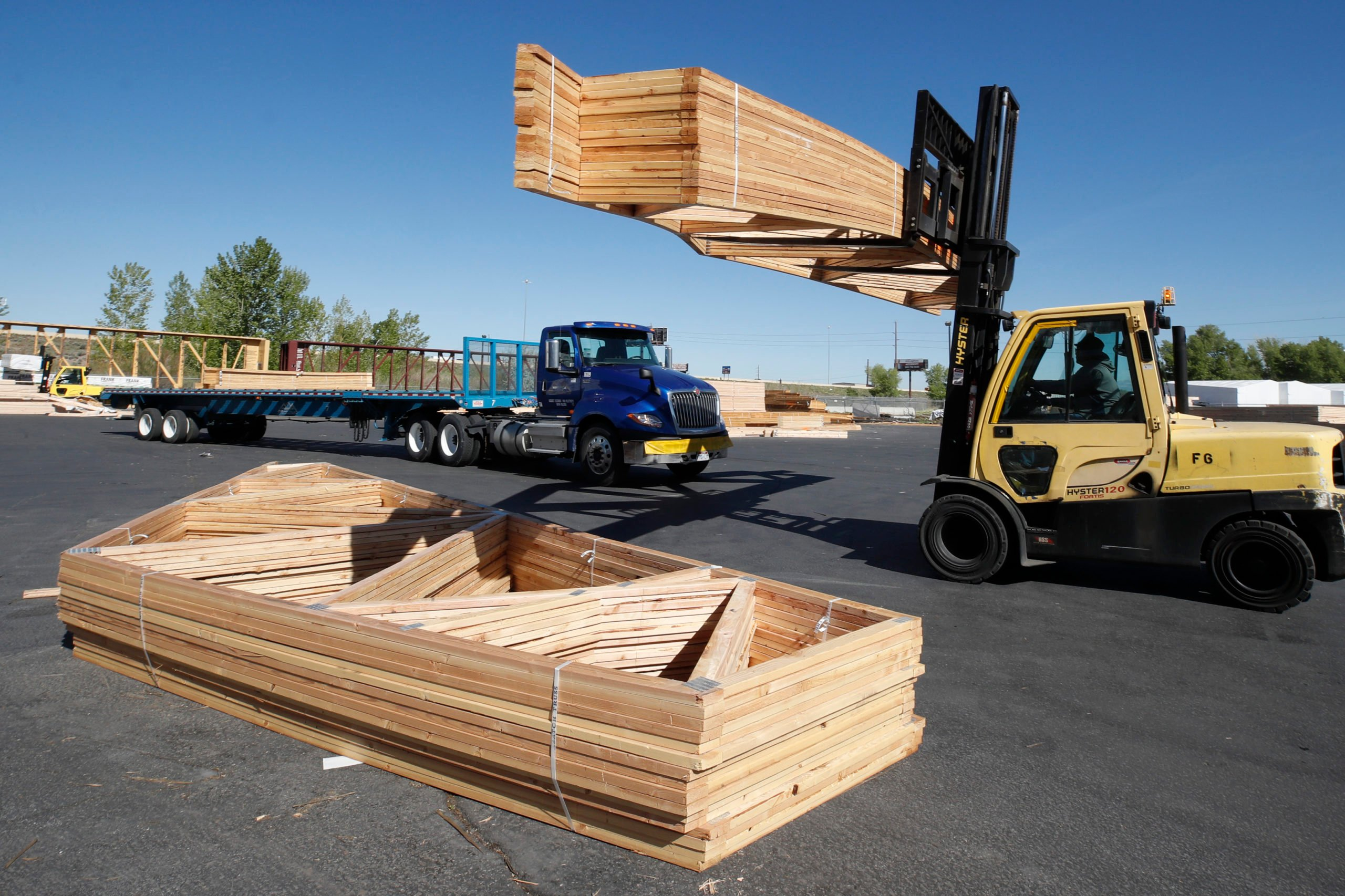 A worker loads finished trusses for homes onto a truck on May 12 in Spanish Fork, Utah. (George Frey/Getty Images)