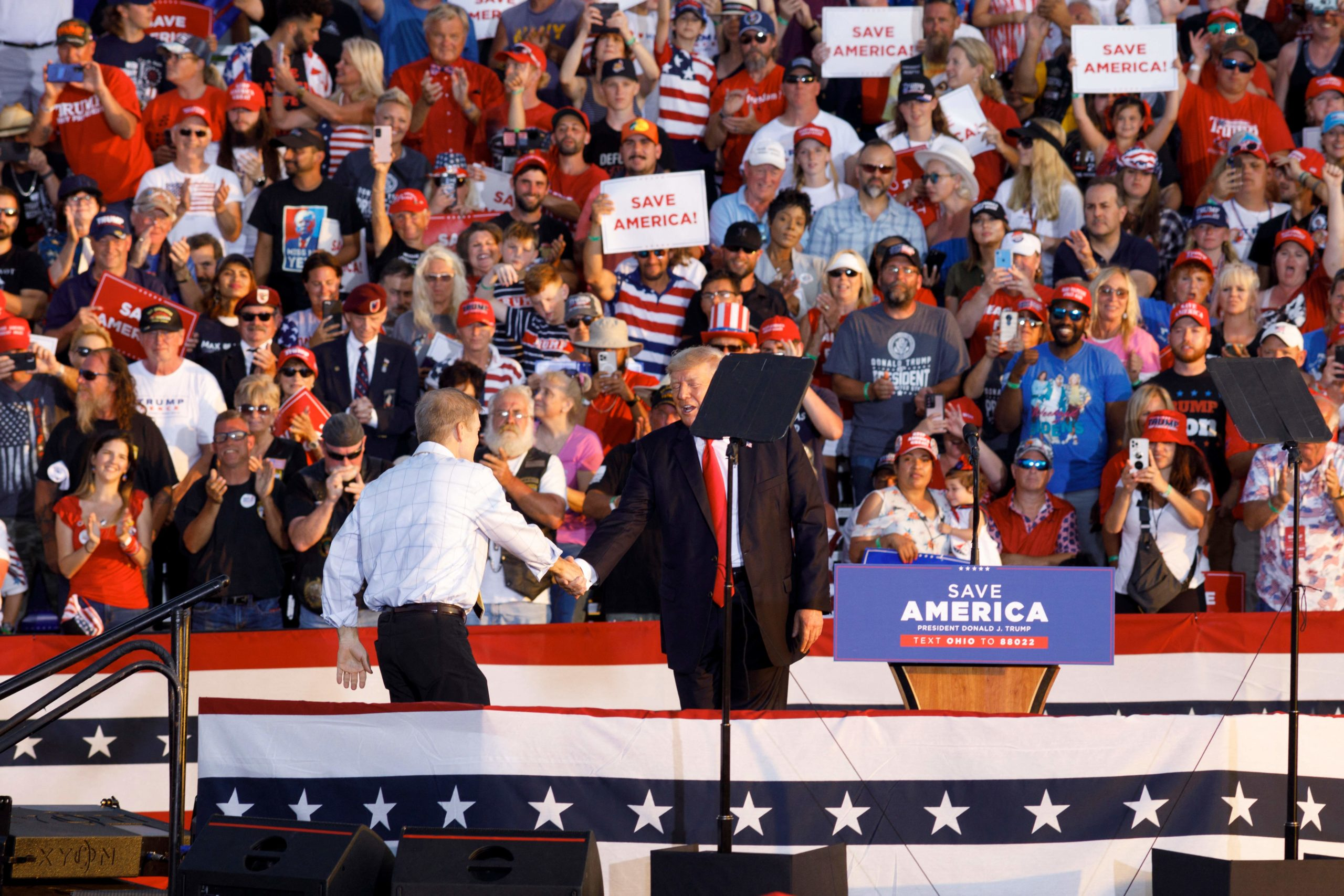 Former US President Donald Trump shakes hands with Jim Jordan, during his rally in Ohio on June 26. (STEPHEN ZENNER/AFP via Getty Images)