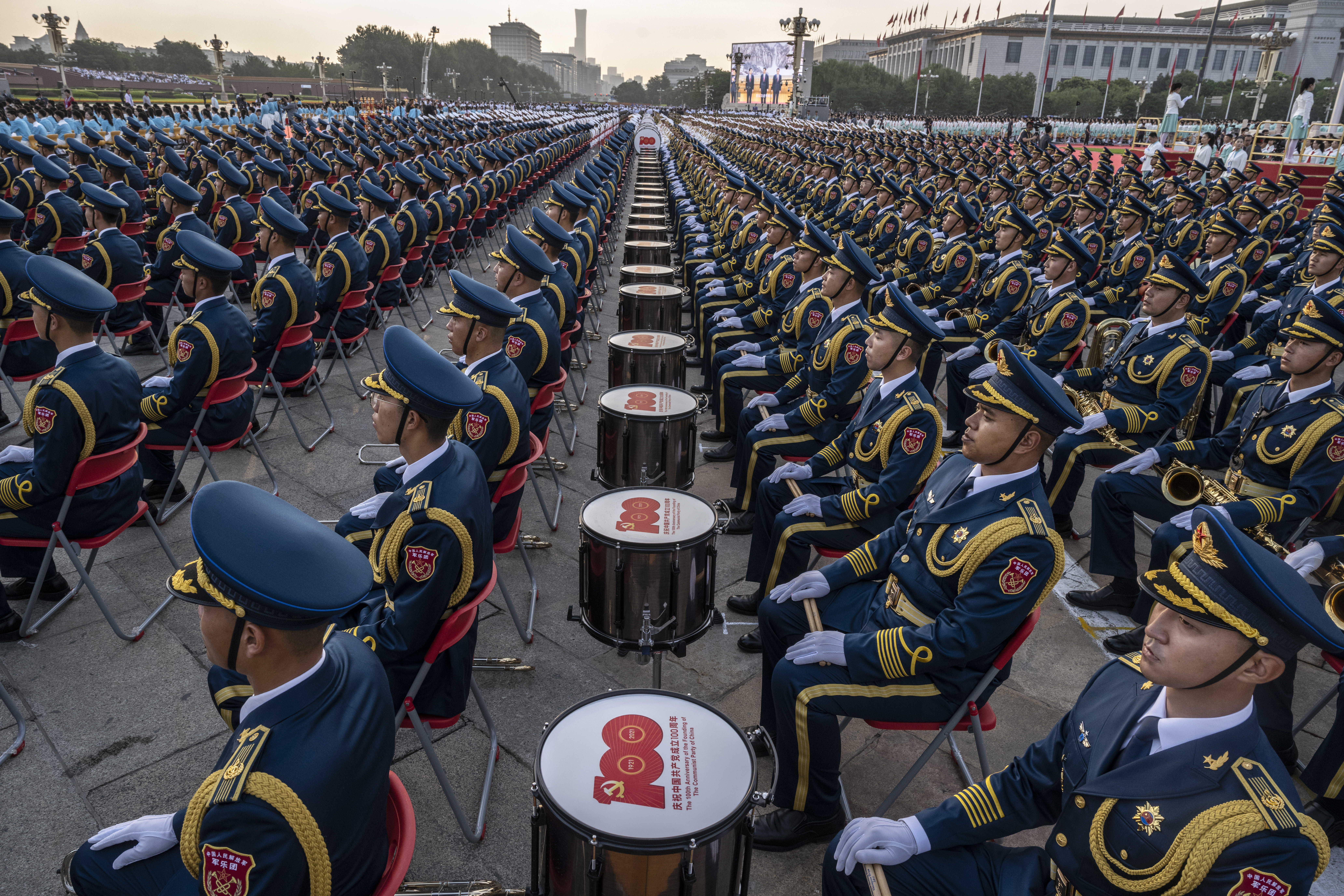 BEIJING, CHINA - JULY 01: Members of a People's Liberation Army ceremonial band sit next to drums with '100' on them at a ceremony marking the 100th anniversary of the Communist Party on July 1, 2021 at Tiananmen Square in Beijing, China. (Photo by Kevin Frayer/Getty Images)
