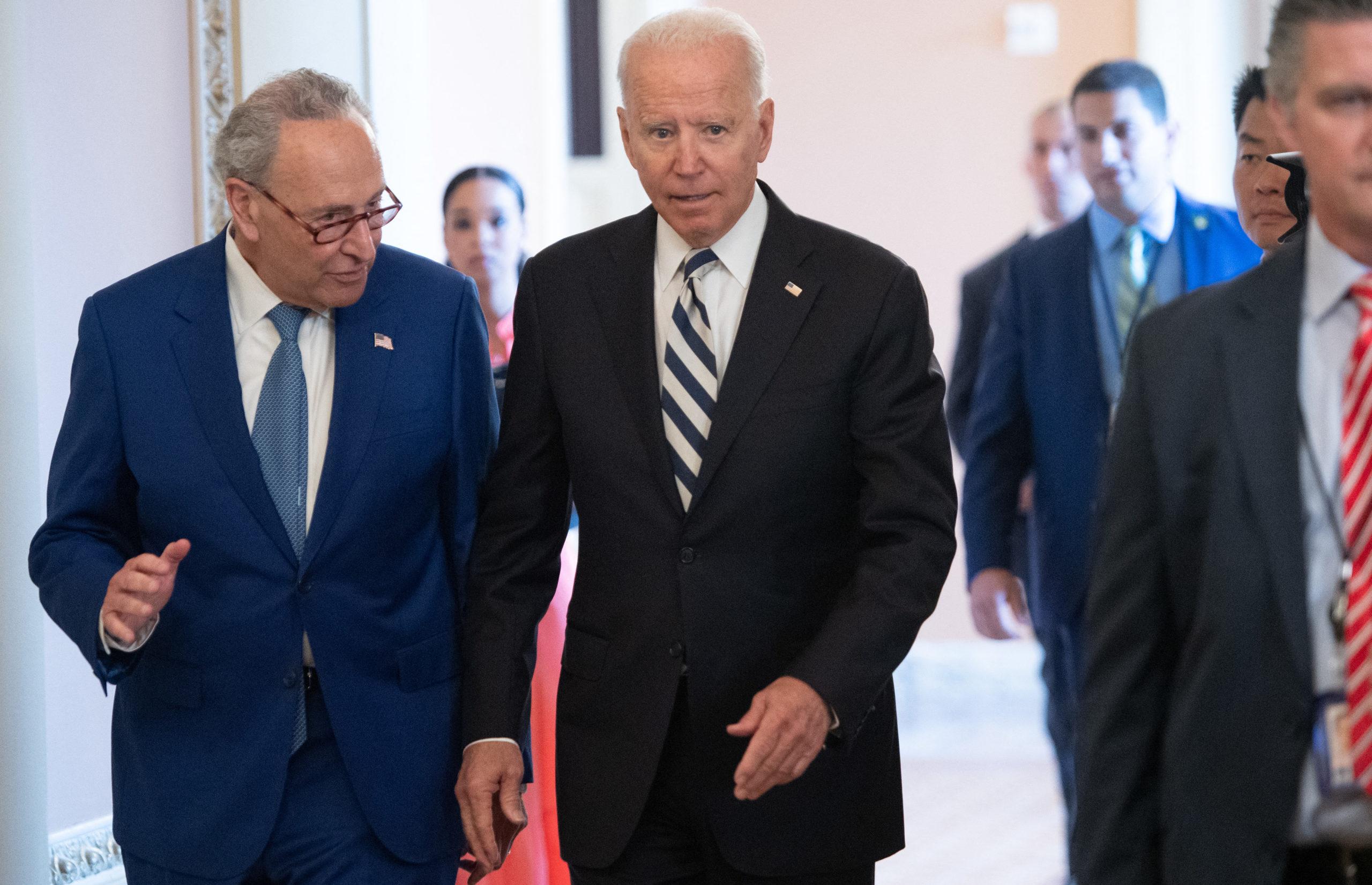 President Joe Biden speaks with Senate Majority Leader Chuck Schumer on July 13 at the Capitol. (Saul Loeb/AFP via Getty Images)