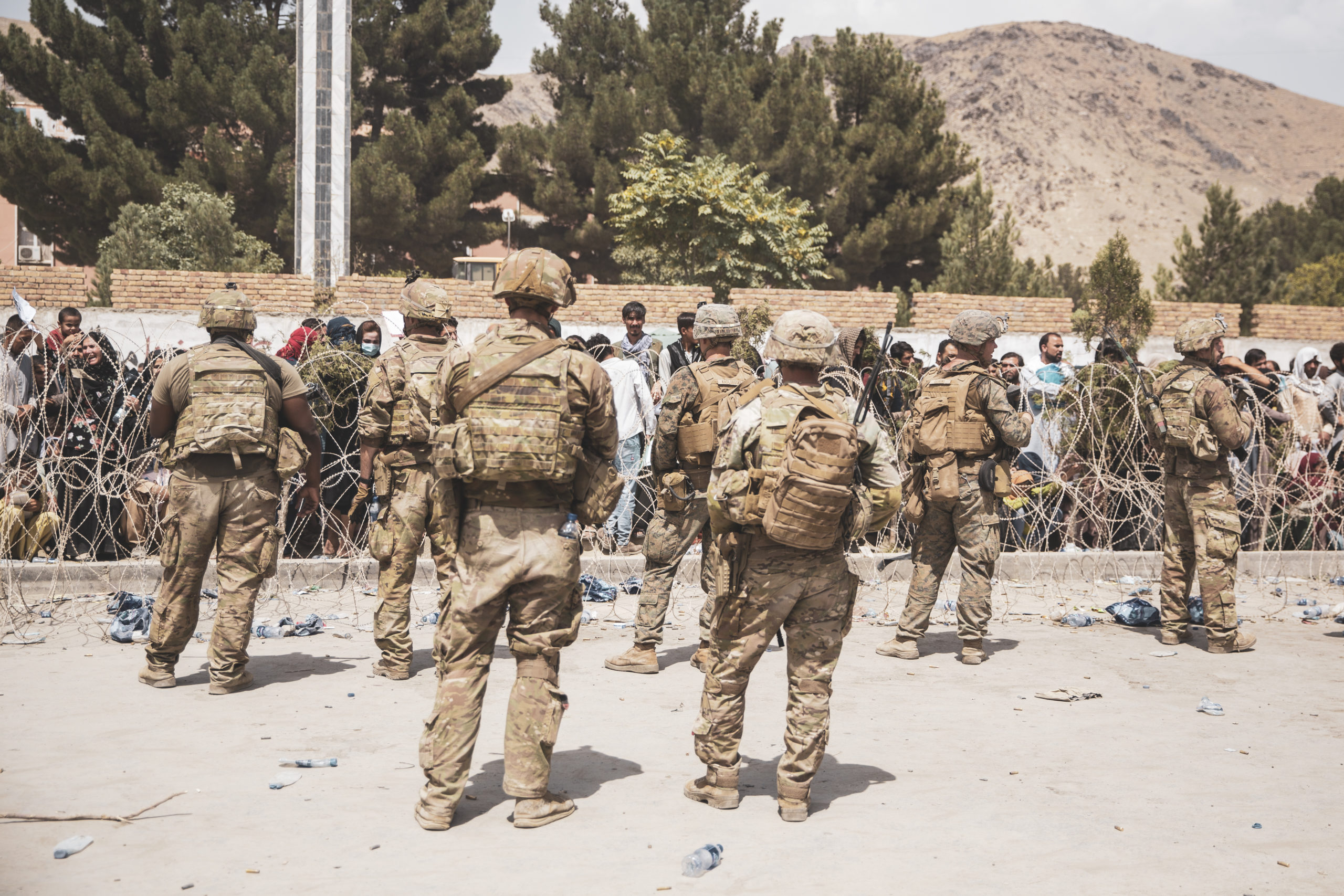 U.S. troops assist with security at an evacuation control checkpoint during at Hamid Karzai International Airport on Aug. 19 in Kabul, Afghanistan. (Staff Sgt. Victor Mancilla/U.S. Marine Corps via Getty Images)