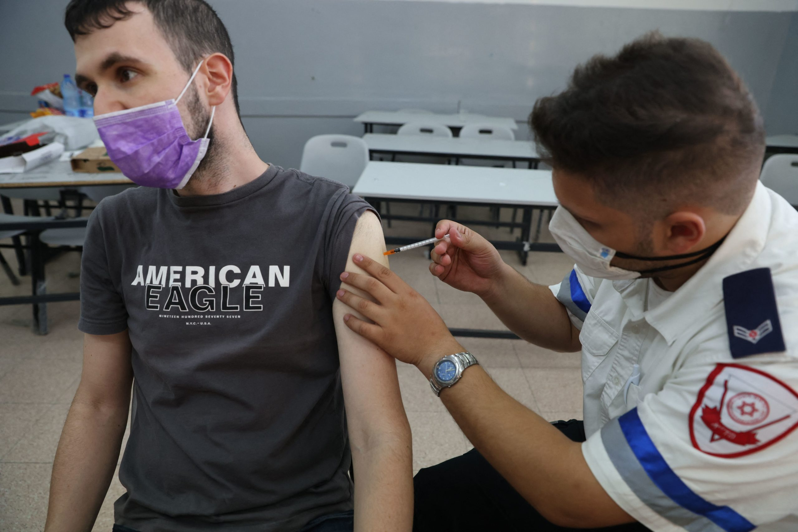 A paramedic with Israel's medical service administers the third shot of the COVID-19 vaccine on Aug. 24 in Holon, Israel. (Ahmad Gharabli/AFP via Getty Images)