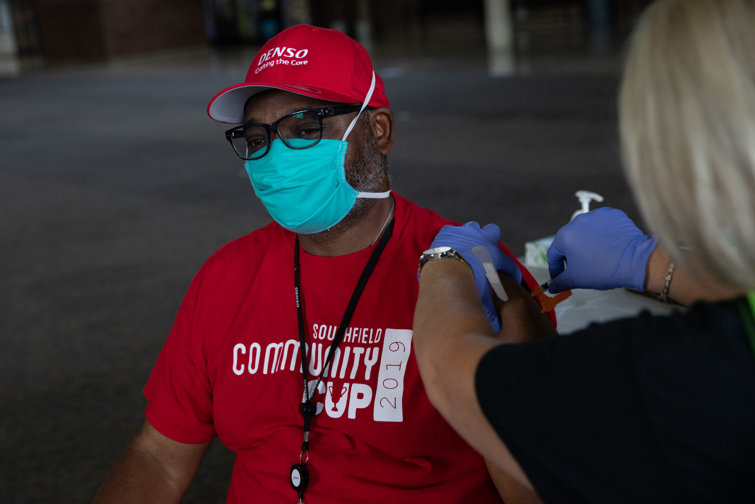 SOUTHFIELD, MI - AUGUST 24: Anthony Faulkner receives his booster dose of the Moderna coronavirus (COVID-19) vaccine during an Oakland County Health Department vaccination clinic at the Southfield Pavilion on August 24, 2021 in Southfield, Michigan. Oakland County is the second county in Michigan to reach the state's goal of vaccinating 70% of its population. (Photo by Emily Elconin/Getty Images)